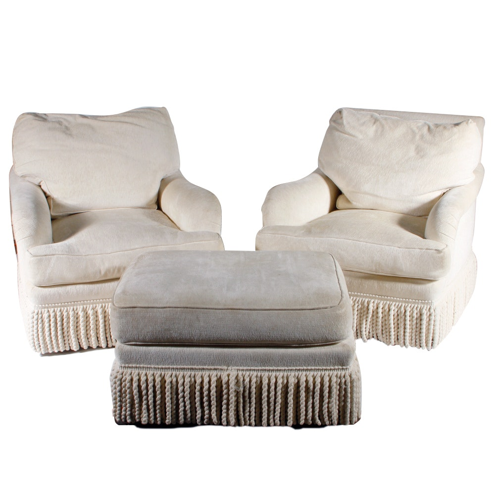 Pair of Upholstered Armchairs and Matching Ottoman