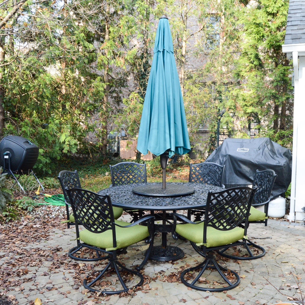 Round Black Metal Patio Table With Swivel Chairs And Umbrella ...
