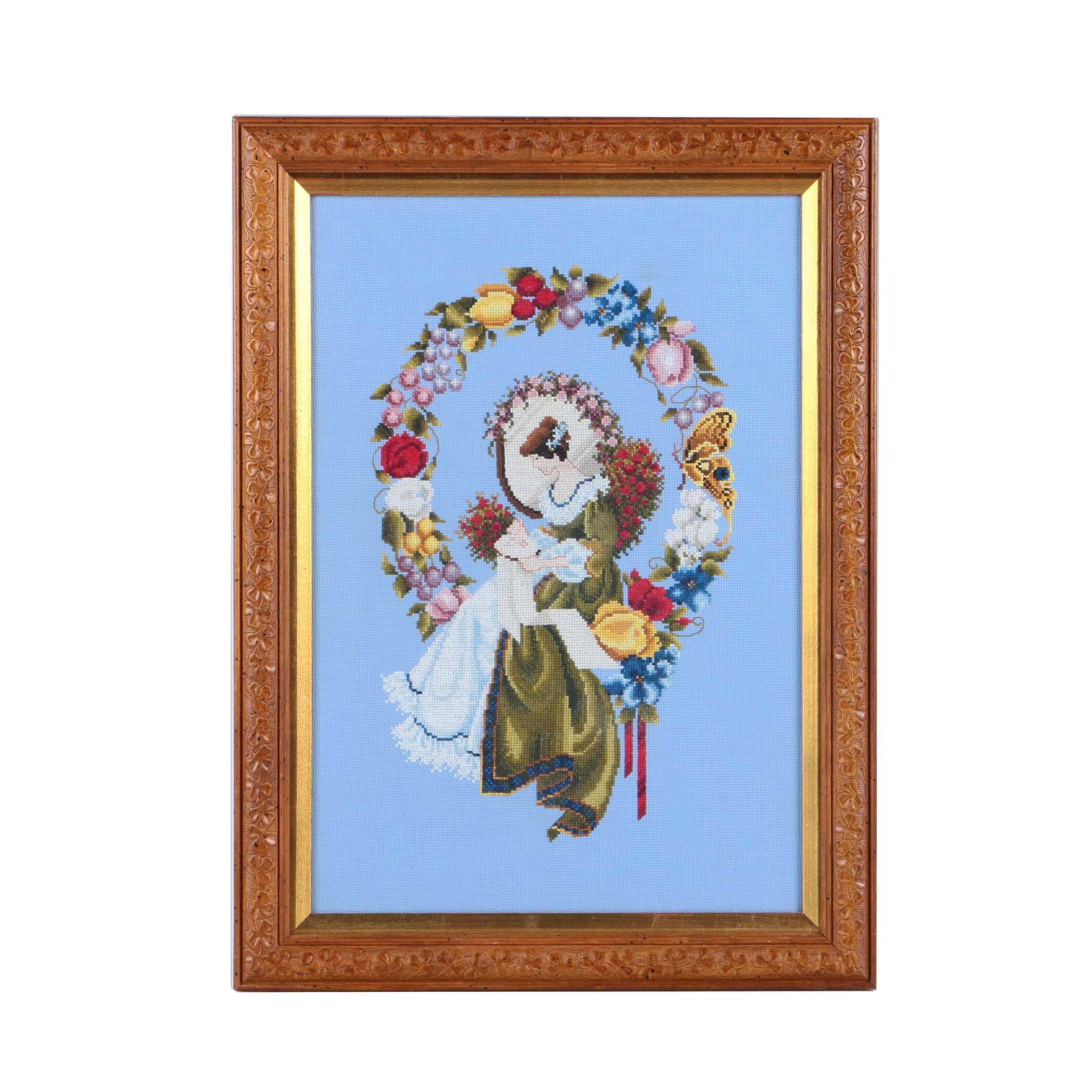 Cross-Stitch Embroidery of a Woman Surrounded by a Wreath