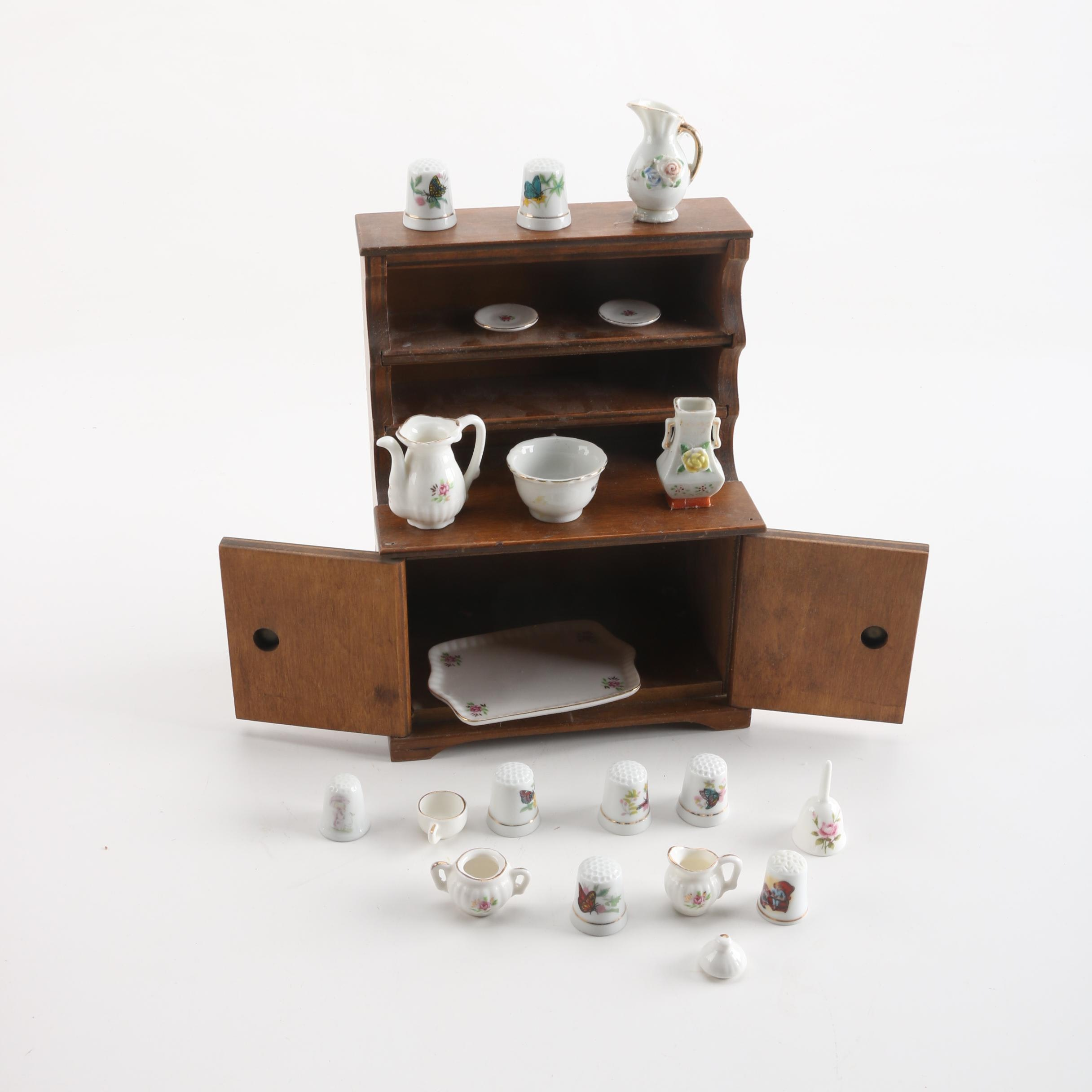 Miniature Wooden Hutch with Porcelain Miniatures and Thimbles