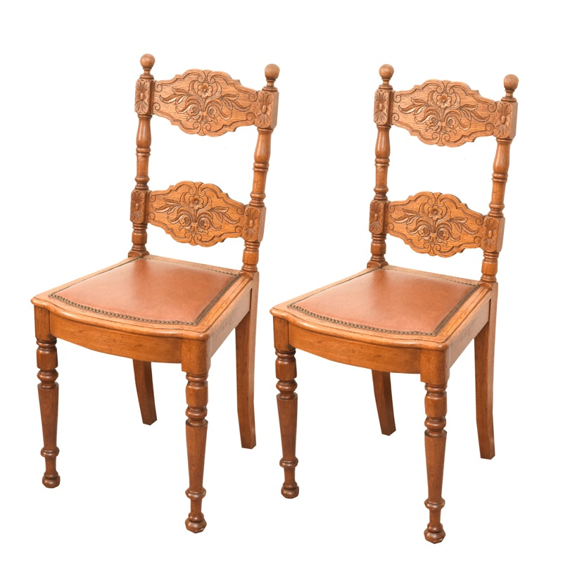 Pair of Carved Oak and Leather Upholstered Side Chairs