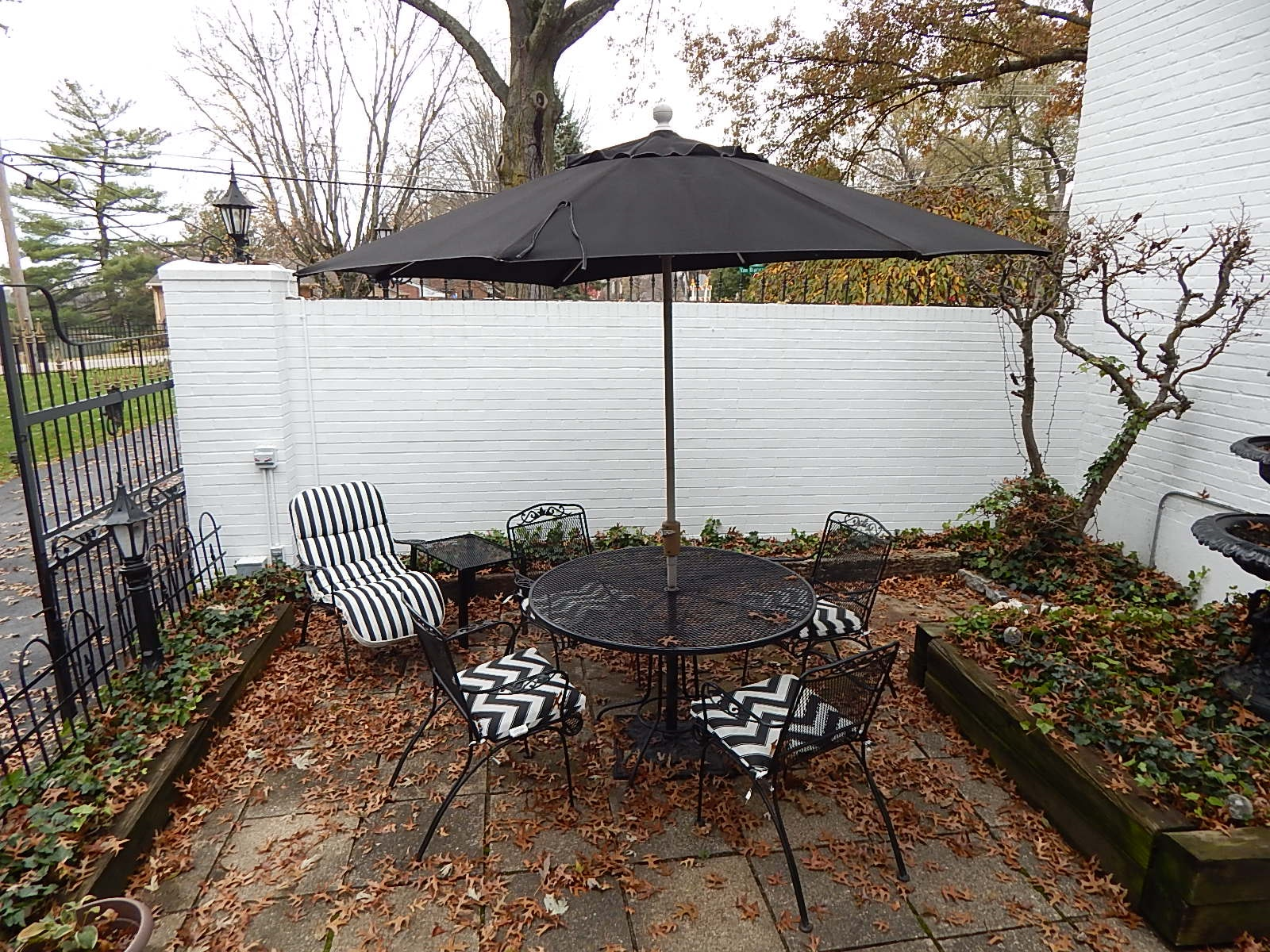 Black Mesh Table and Chairs with Umbrella
