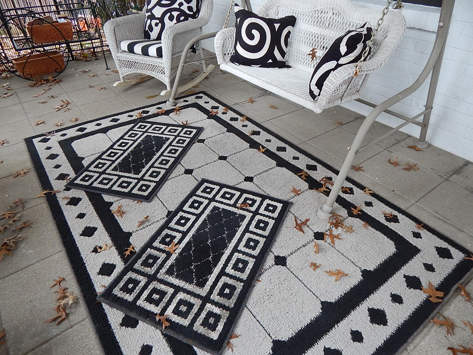Wicker Chair and Swing with Rugs