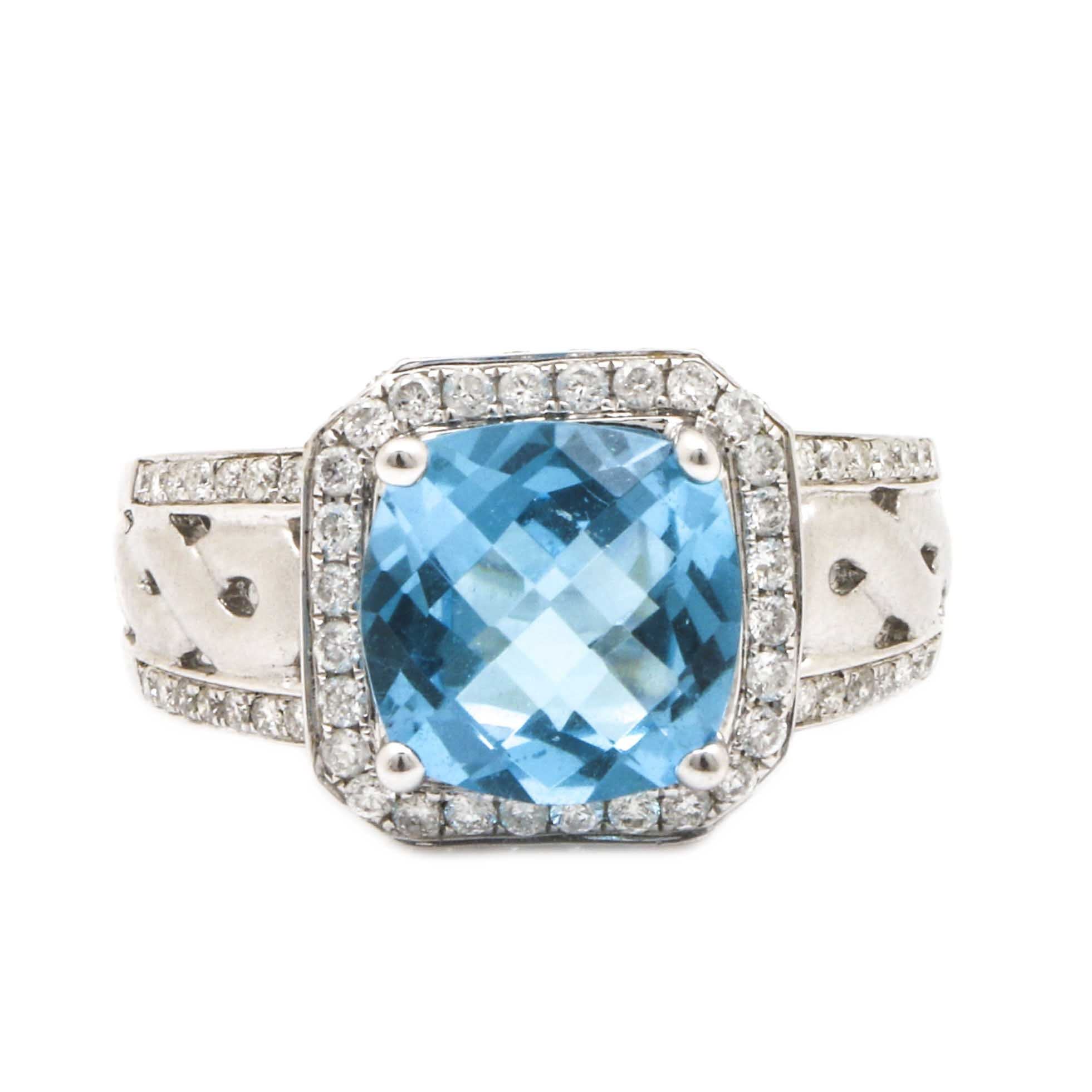 18K White Gold Blue Topaz and 0.91 CTW Diamond Ring