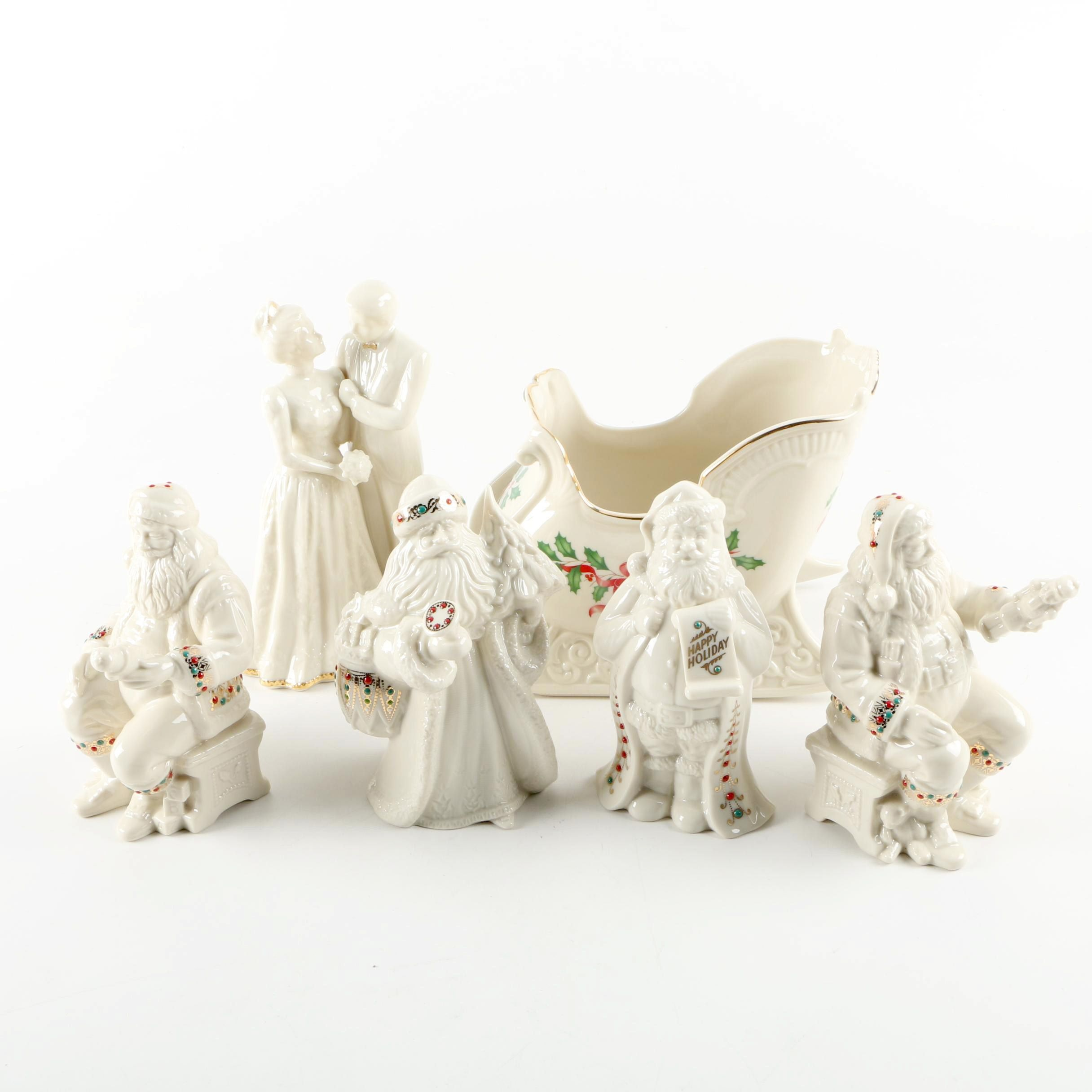 "Lenox Christmas and ""Wedding Promises"" Figurines"