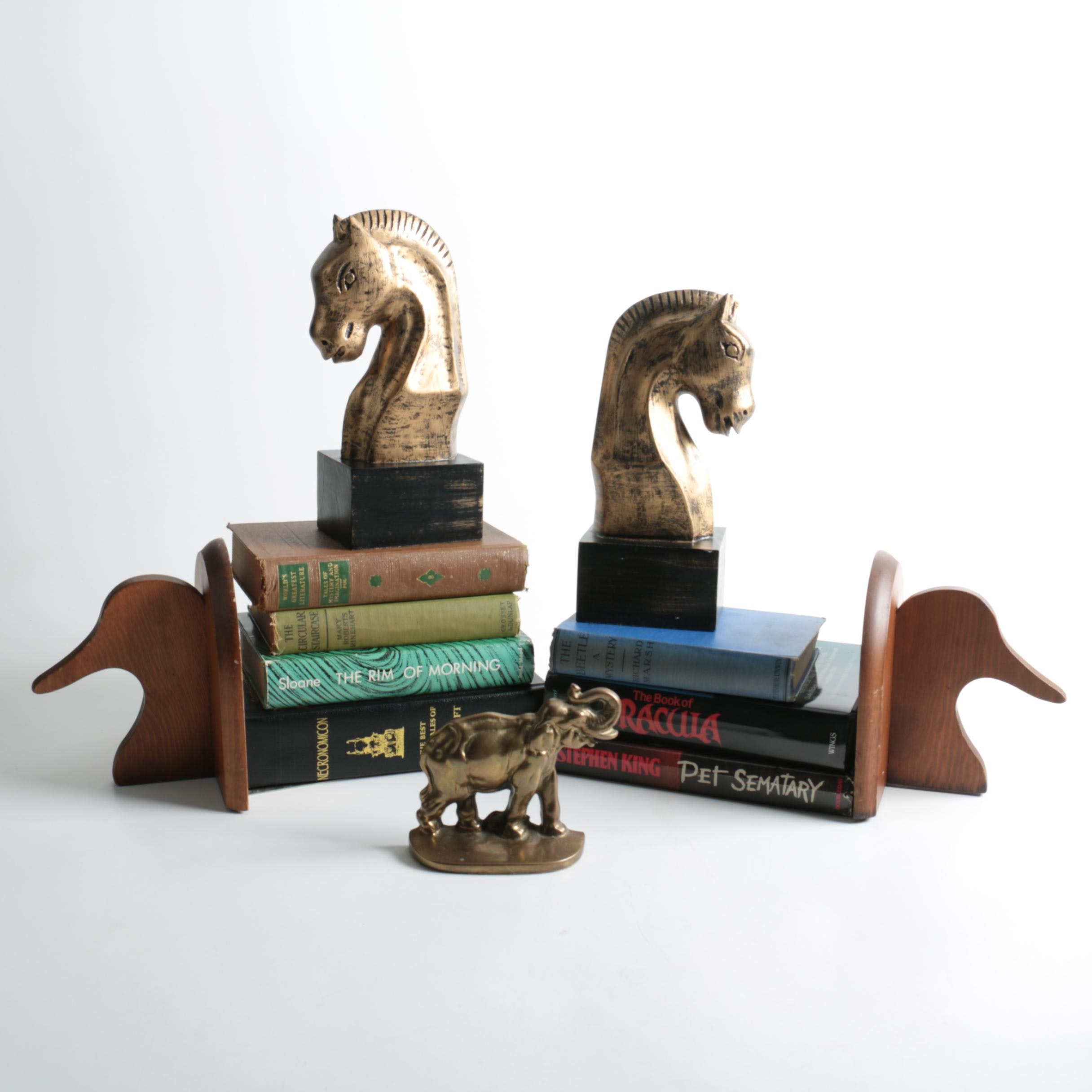 Assortment of Fiction Books and Bookends