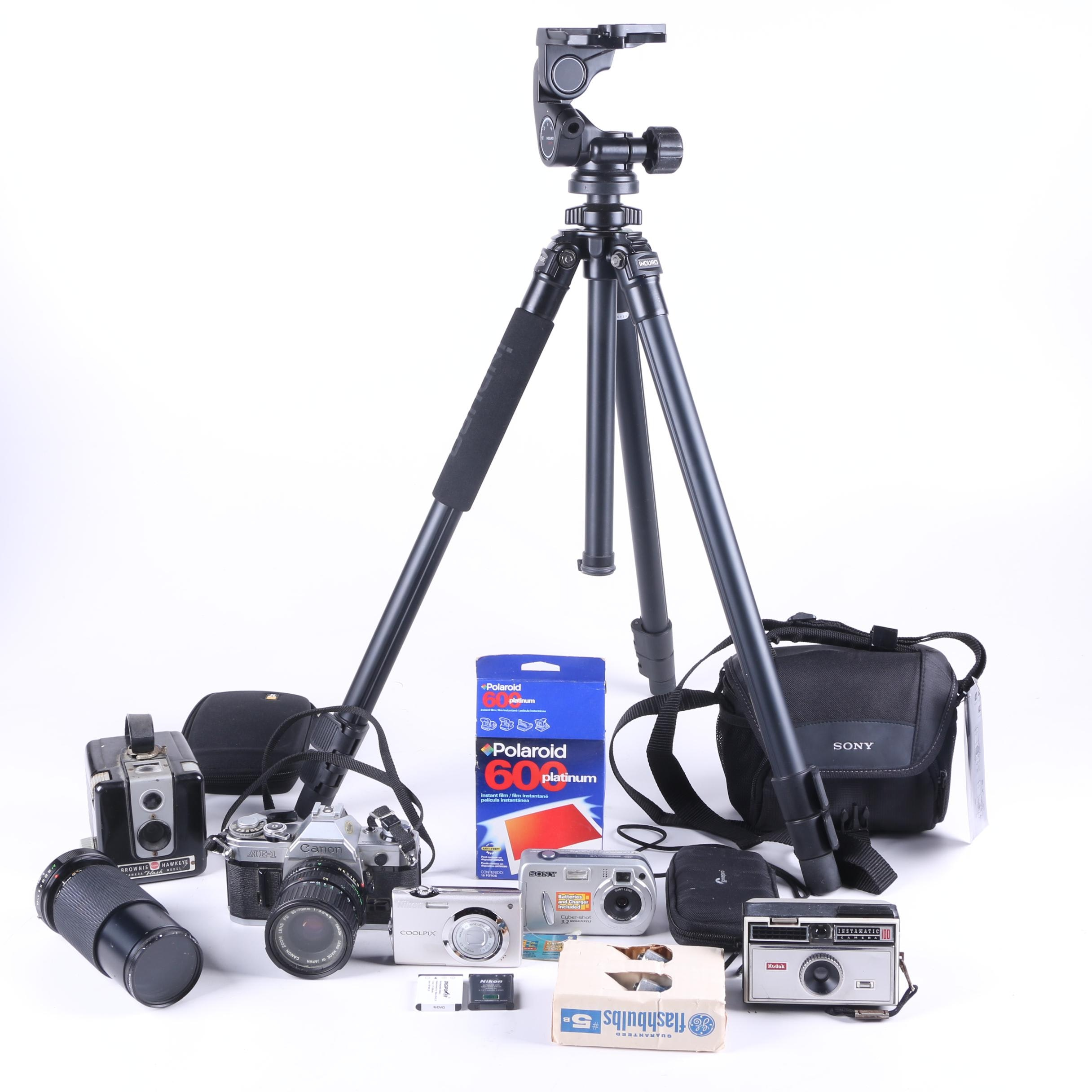 Assortment of Cameras and Tripod