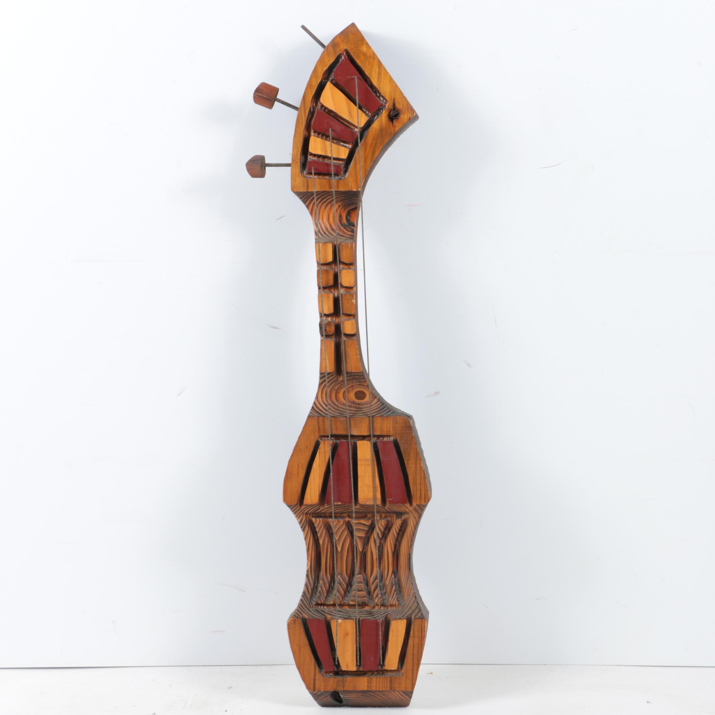 Witco Carved Wooden Guitar Sculpture