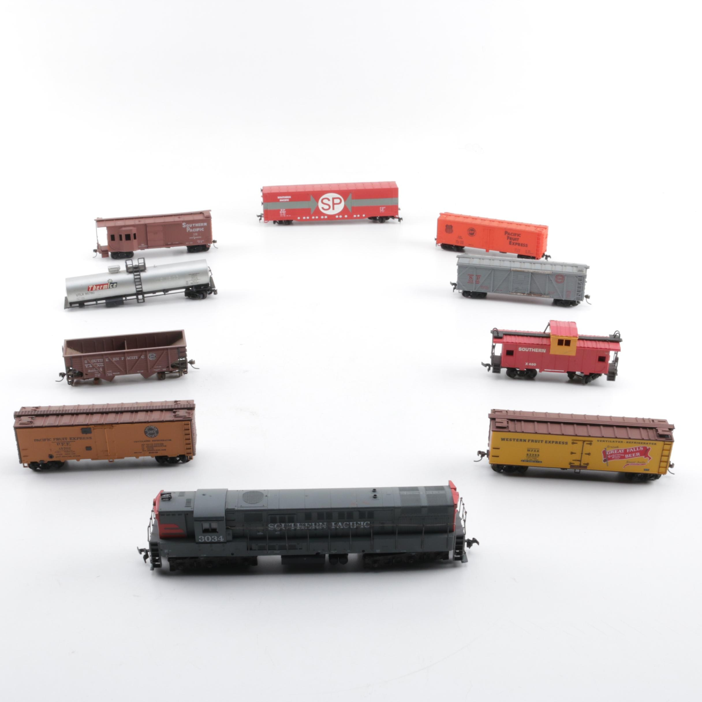 Assorted HO Scale Train Cars Including Varney