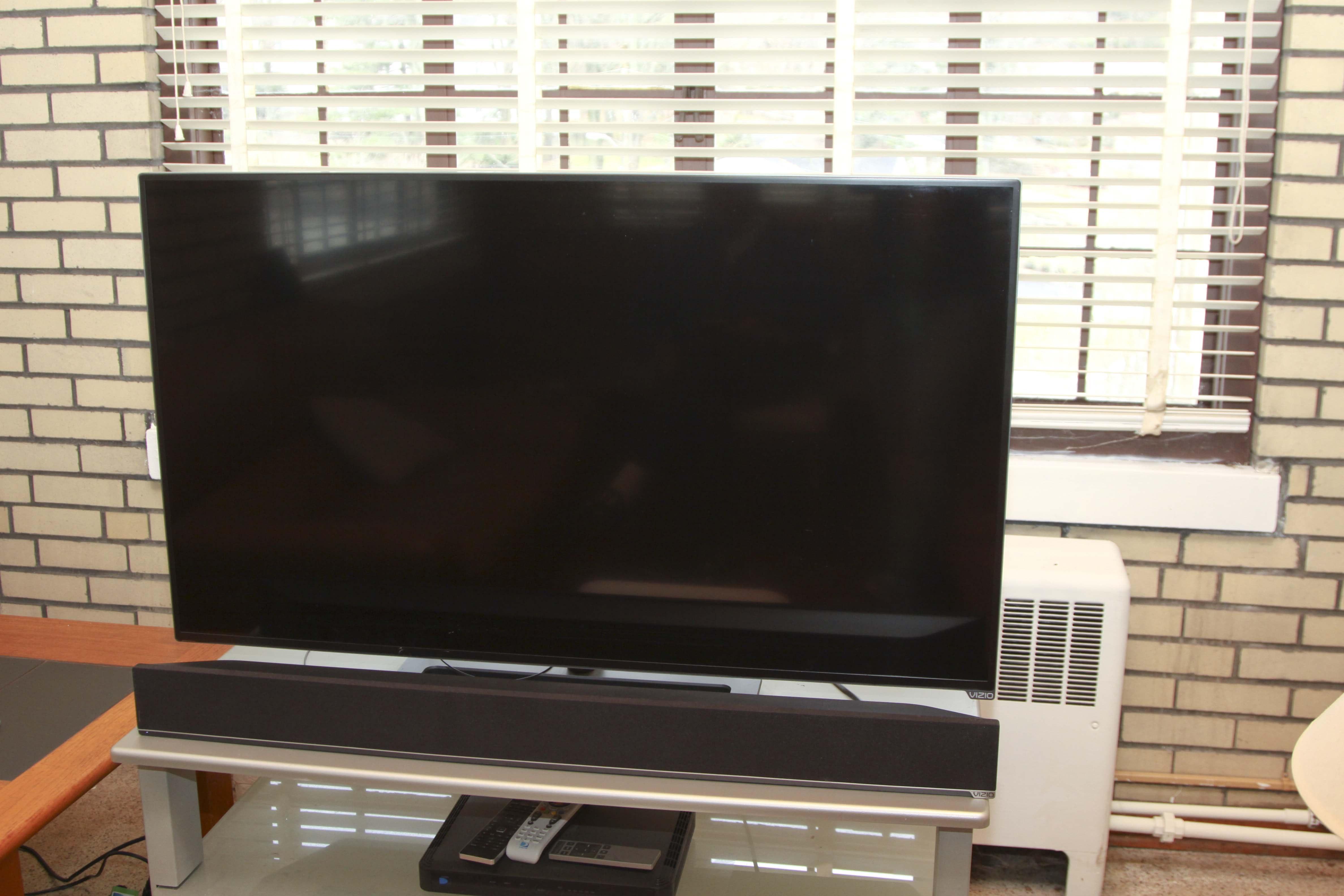 "Vizio 49"" Flat Screen Television and Sound Bar"