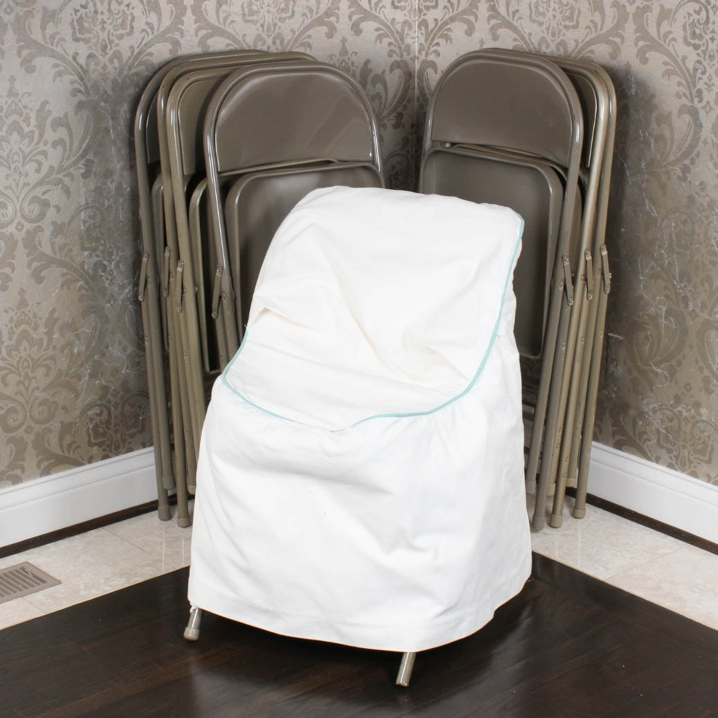 Eight Folding Chairs with Slip Covers