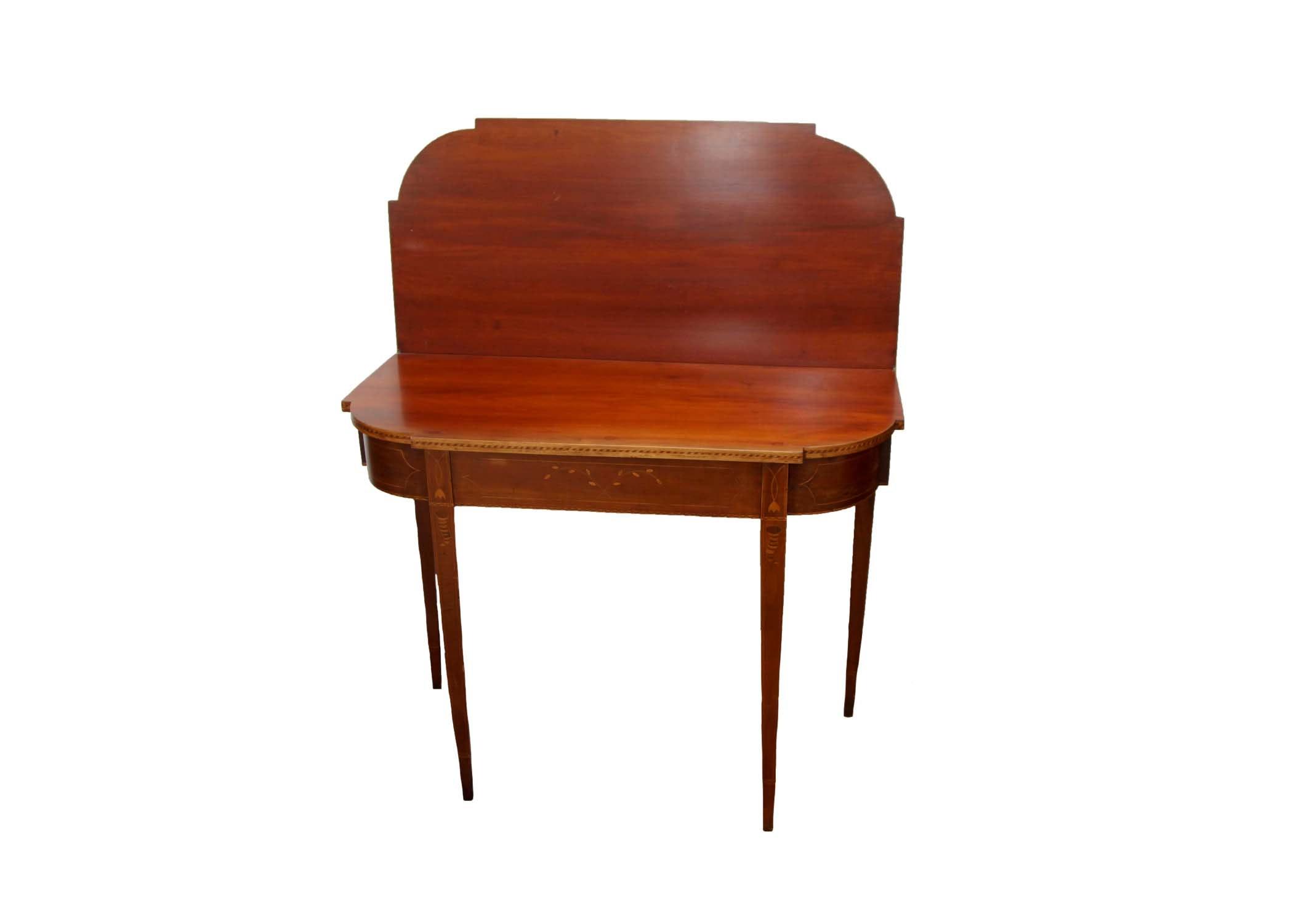 An Antique Flip Top Table