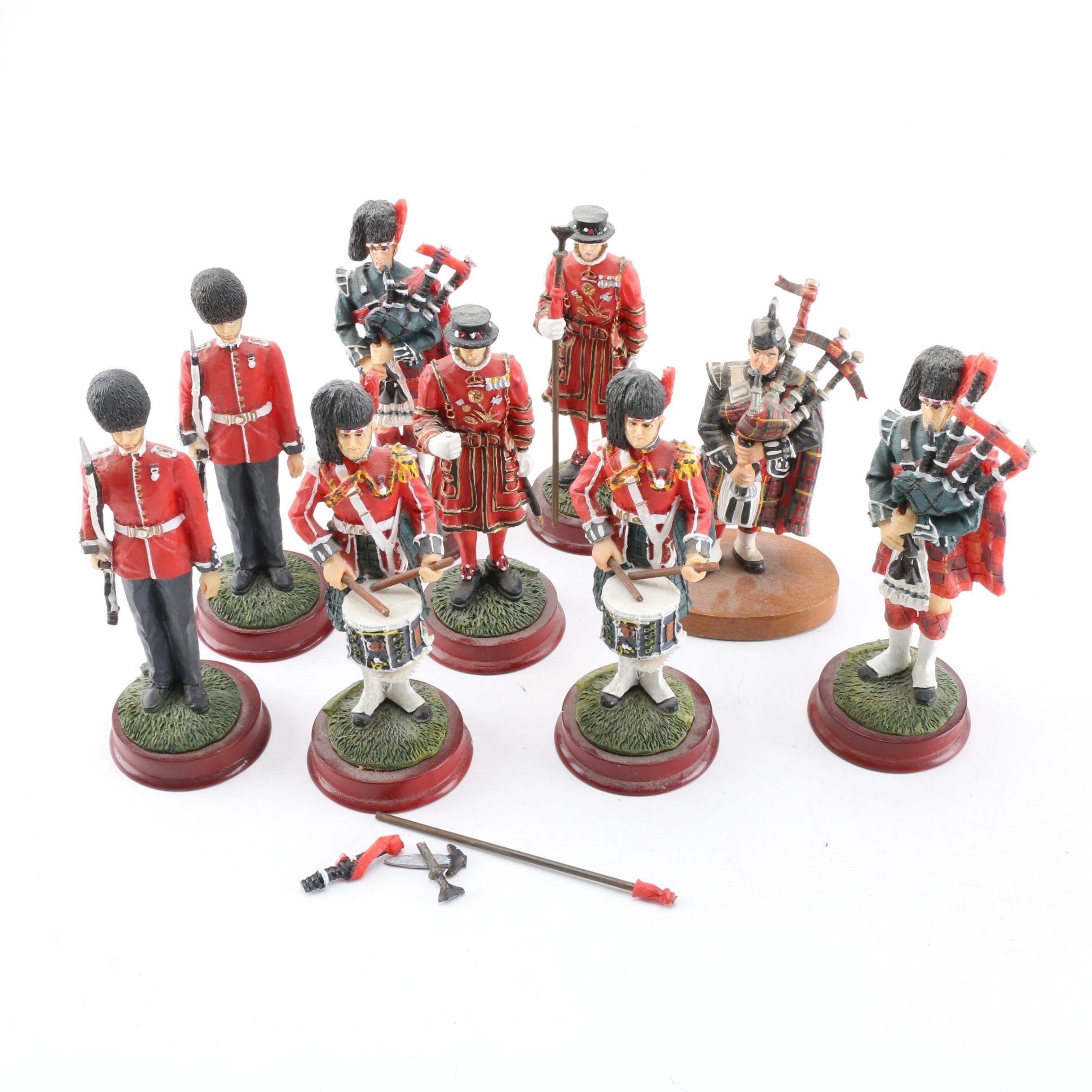 British Military Figurines Including Bagpipers and Beefeaters