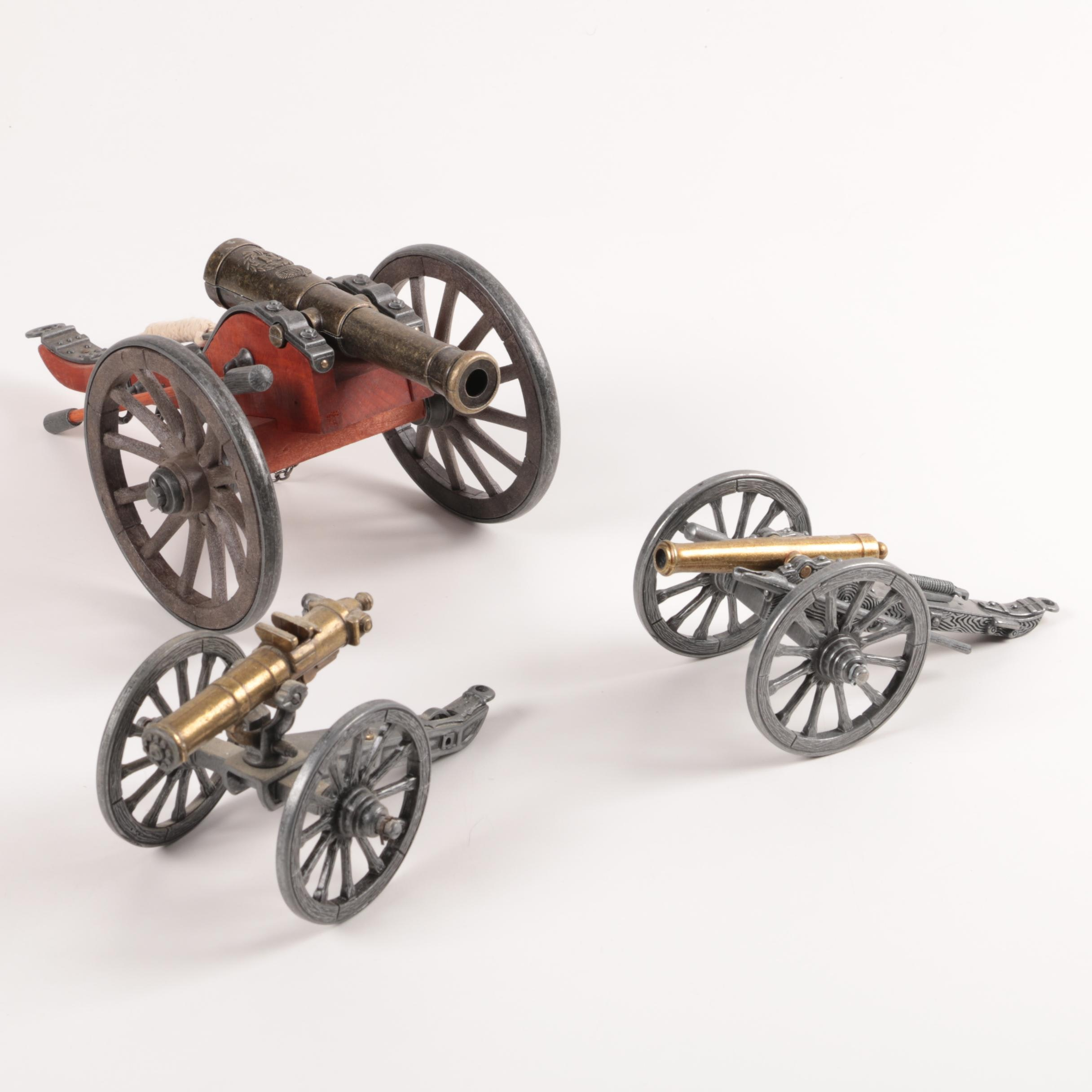 Collection of Cannon and Gatling Figurines