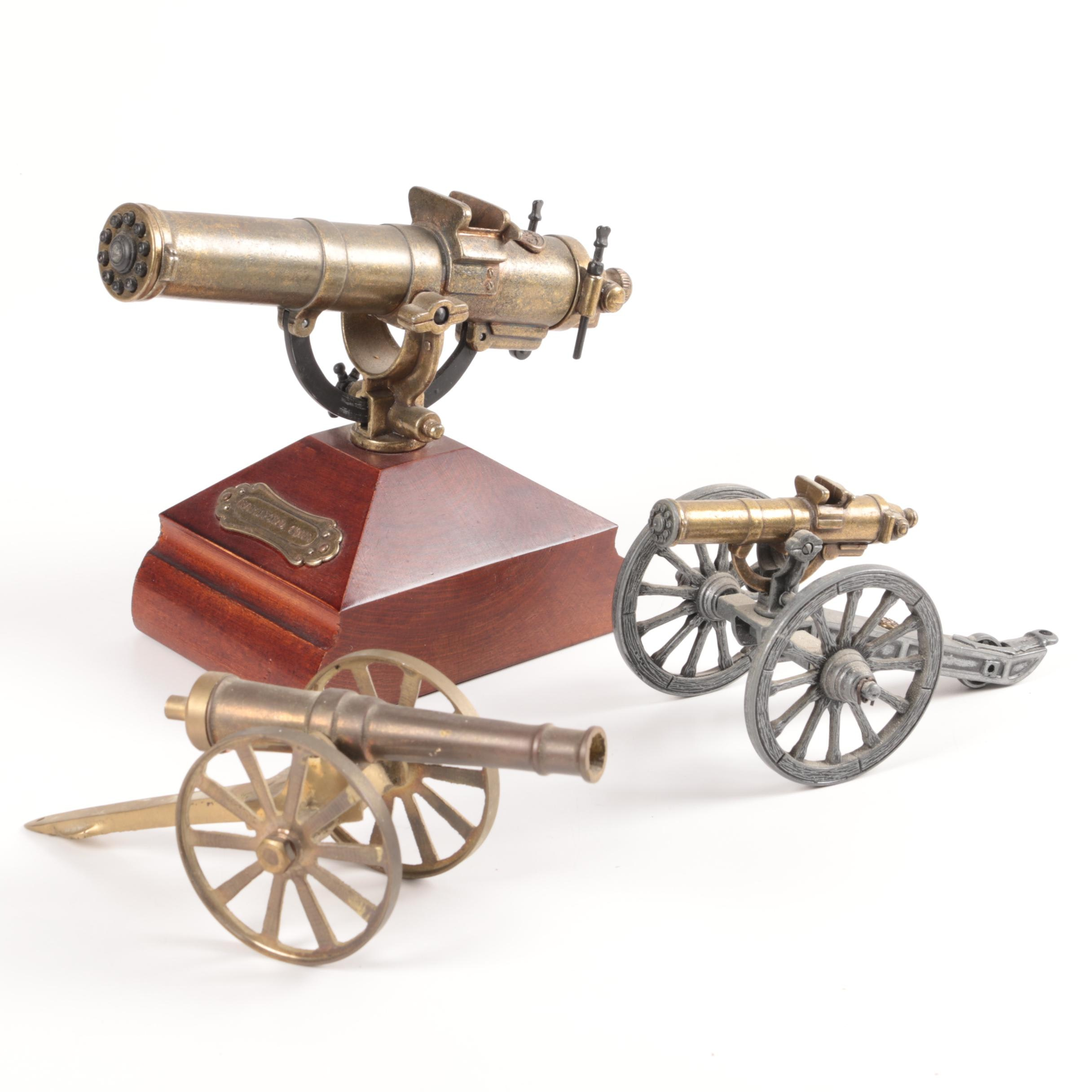Pair of Gatling Gun Figurines with Cannon Figurine