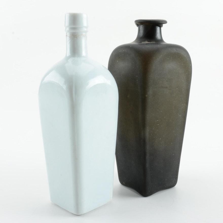 Vintage Milk Glass Bottle And A Black Glass Vase Ebth