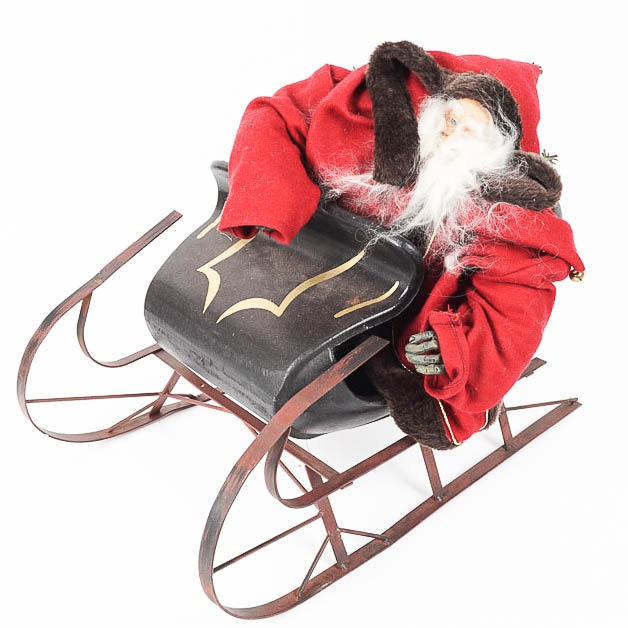 Large Santa Figurine on a Metal Sled