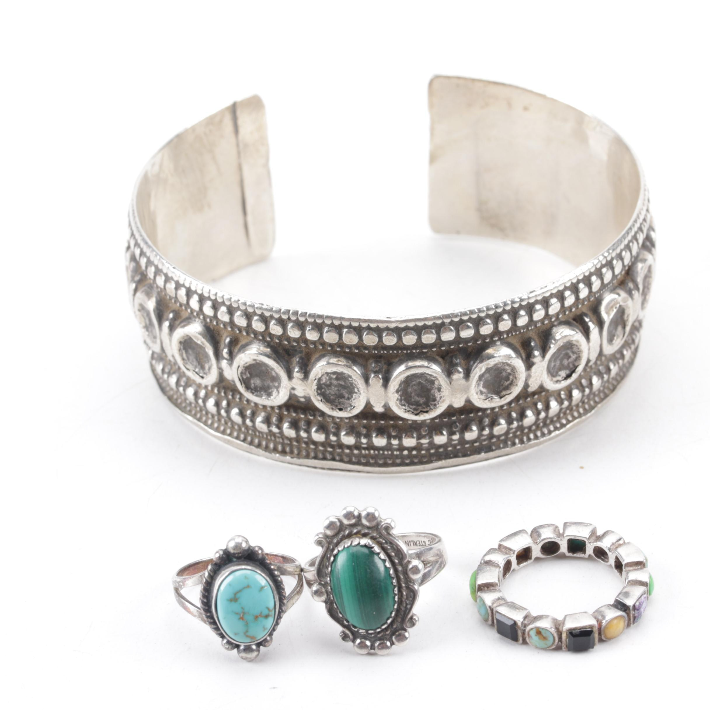 800 Silver Cuff Bracelet and Three Sterling Silver Rings Set with Mixed Stones