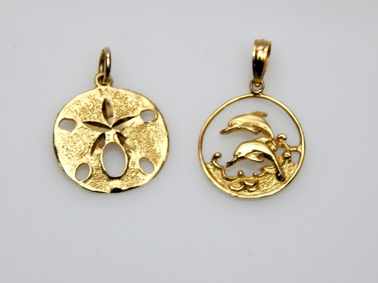 14K Yellow Gold Sand Dollar and Dolphin Pendants