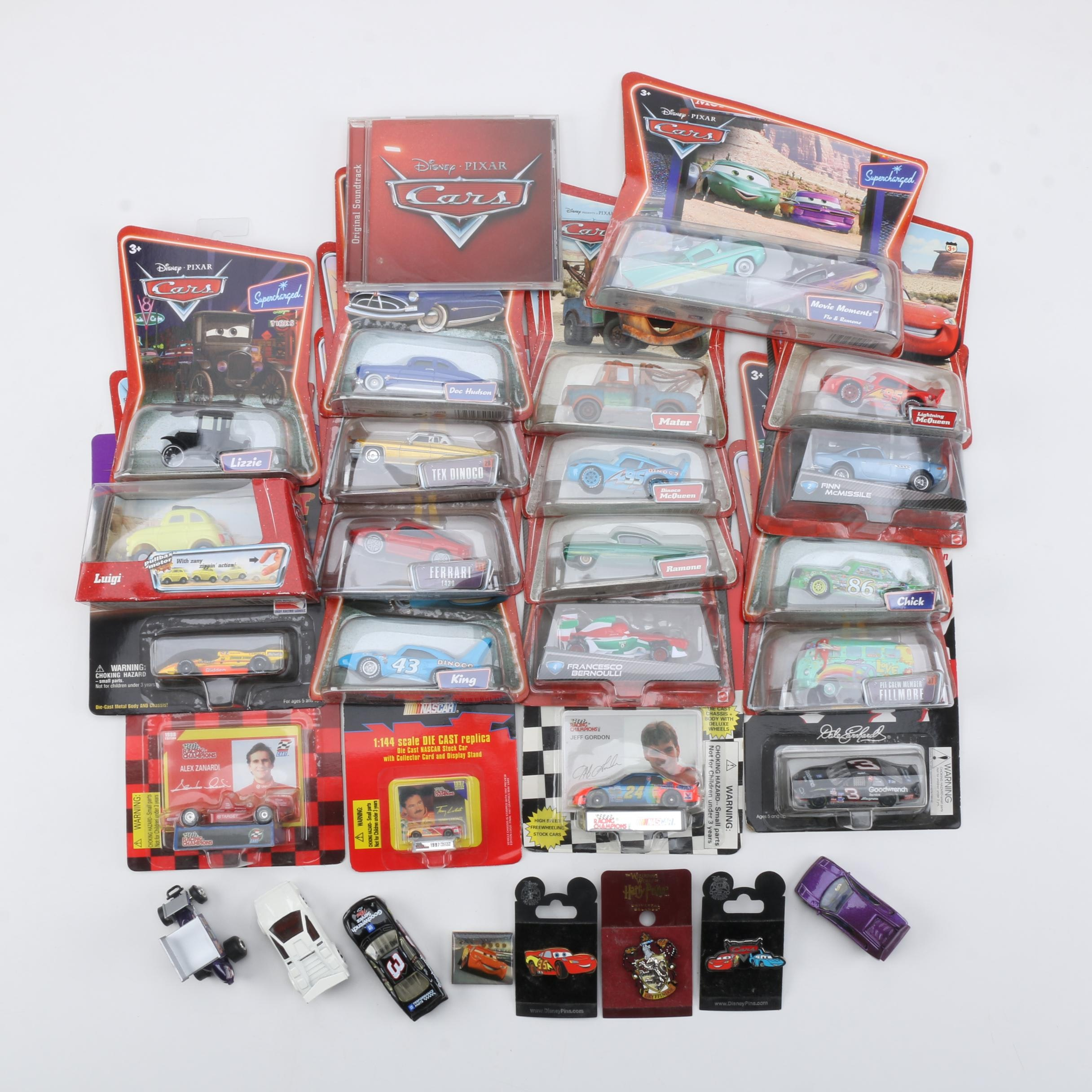"Assorted Die-Cast Cars and Movie Memorabilia Featuring ""Cars"""