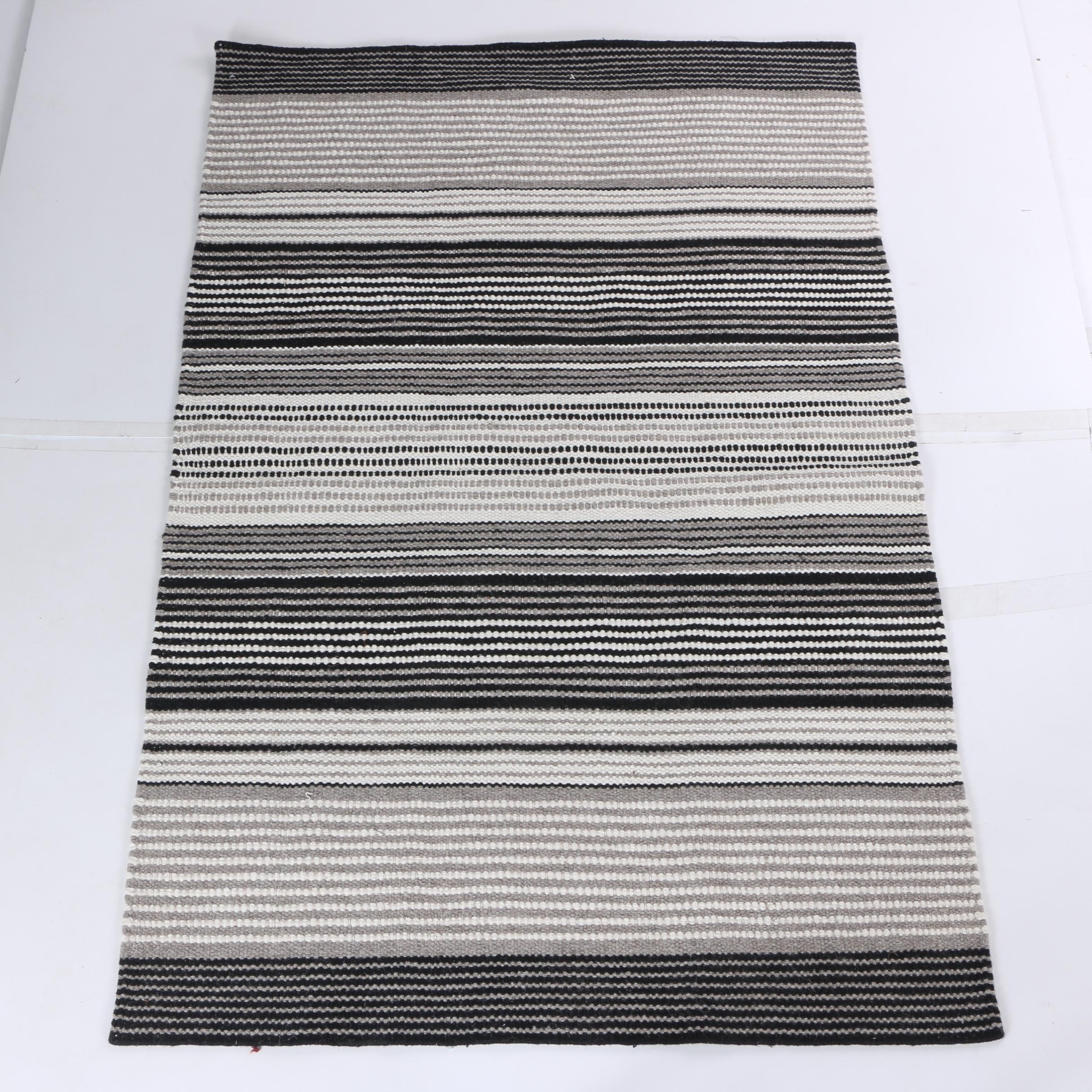 Power-Loomed Gray, Black, and White Area Rug