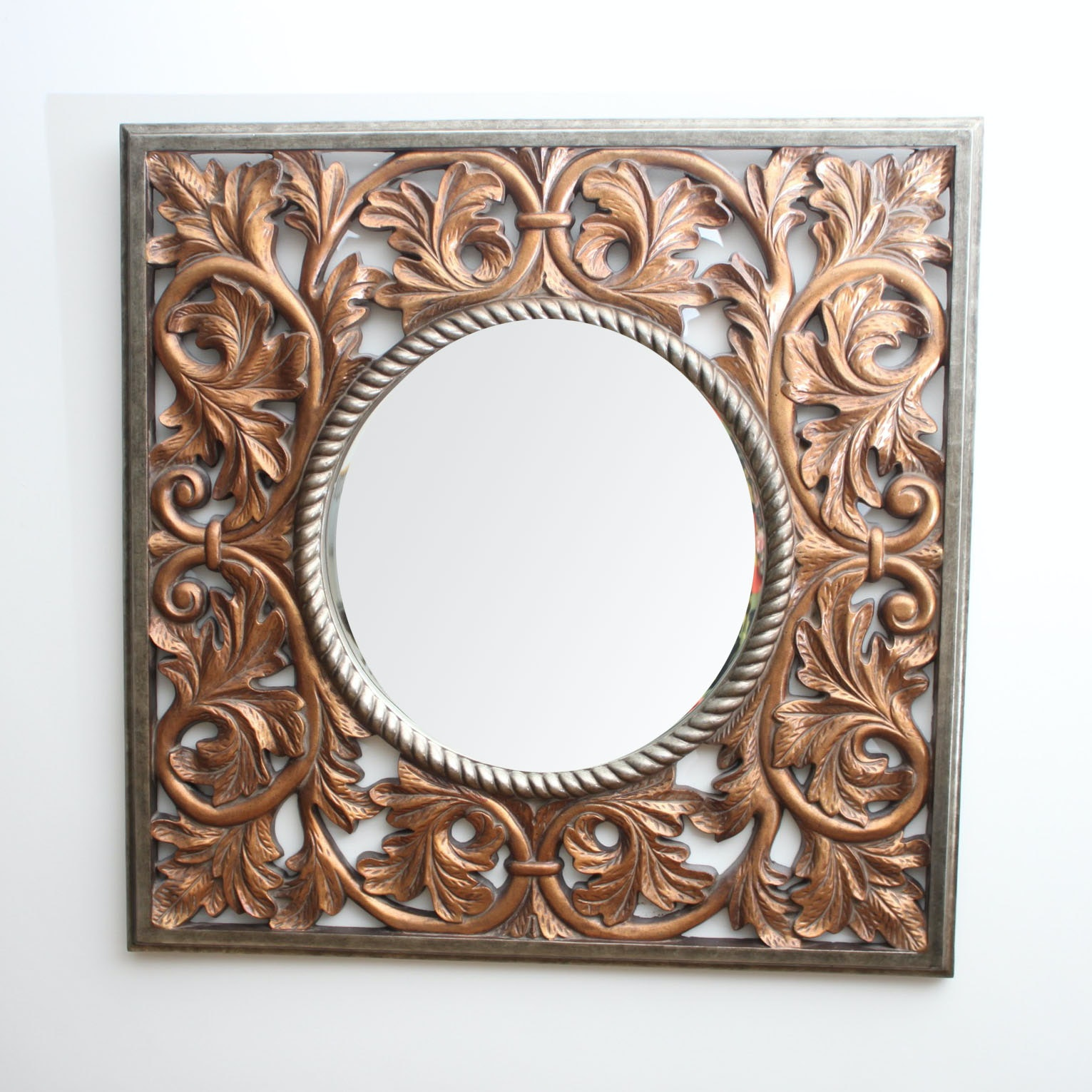 Gold Tone Wall Mirror with Scrolled Leaf Motif