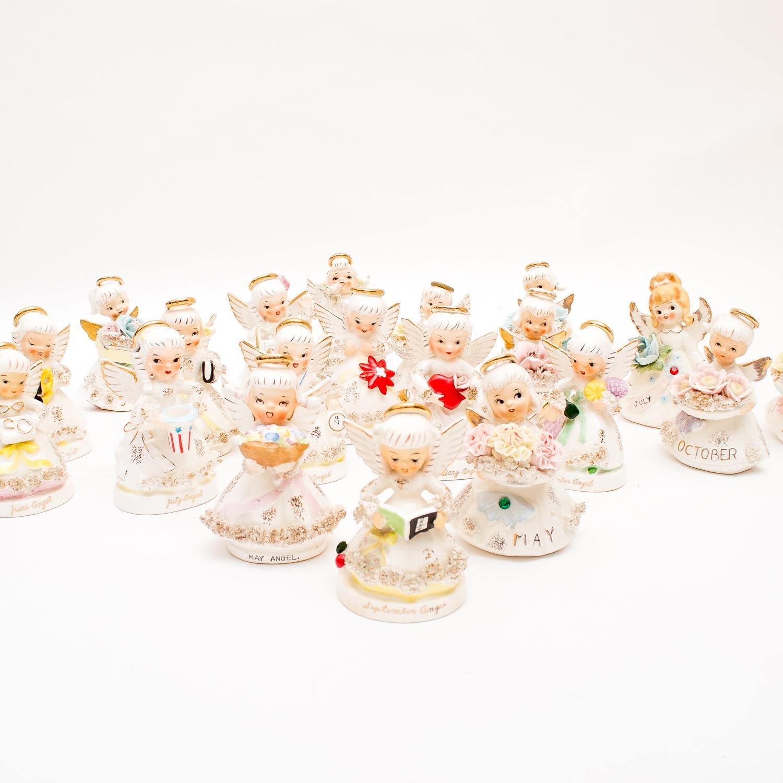 Grouping of Lefton Birthday Angel Figurines