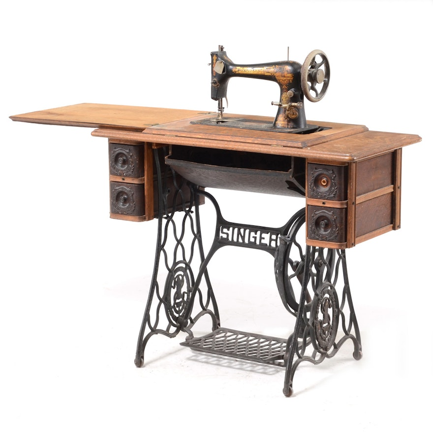 antique oak singer sewing machine table with accessories ebth. Black Bedroom Furniture Sets. Home Design Ideas