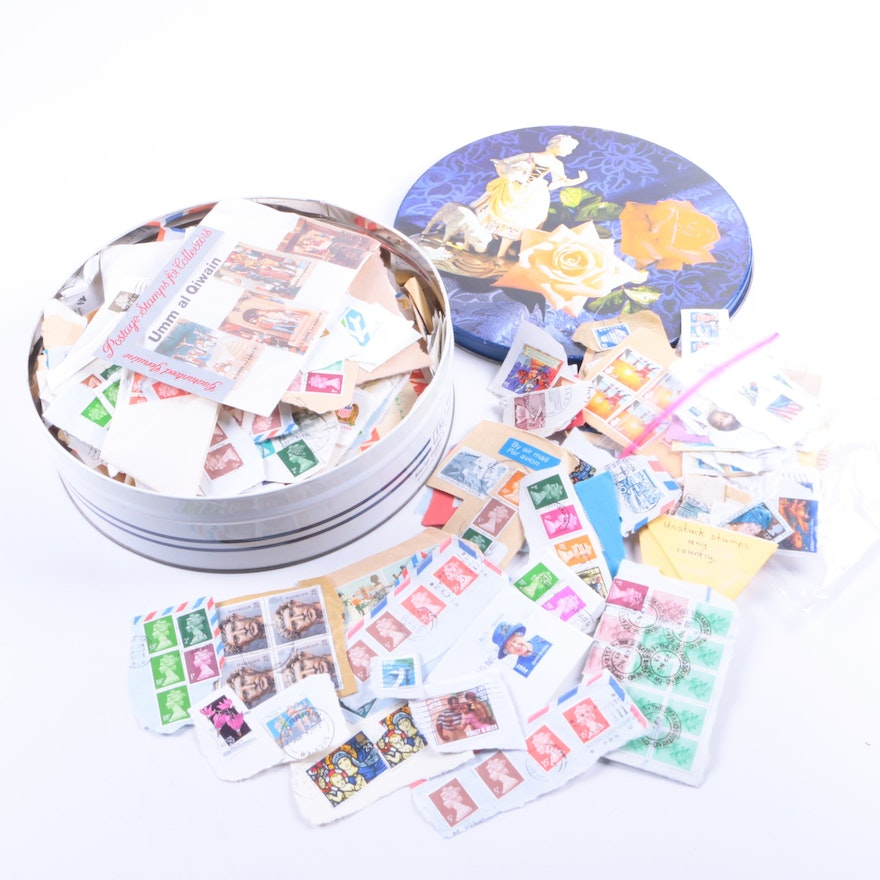 International stamp collection in round tin ebth for International collection