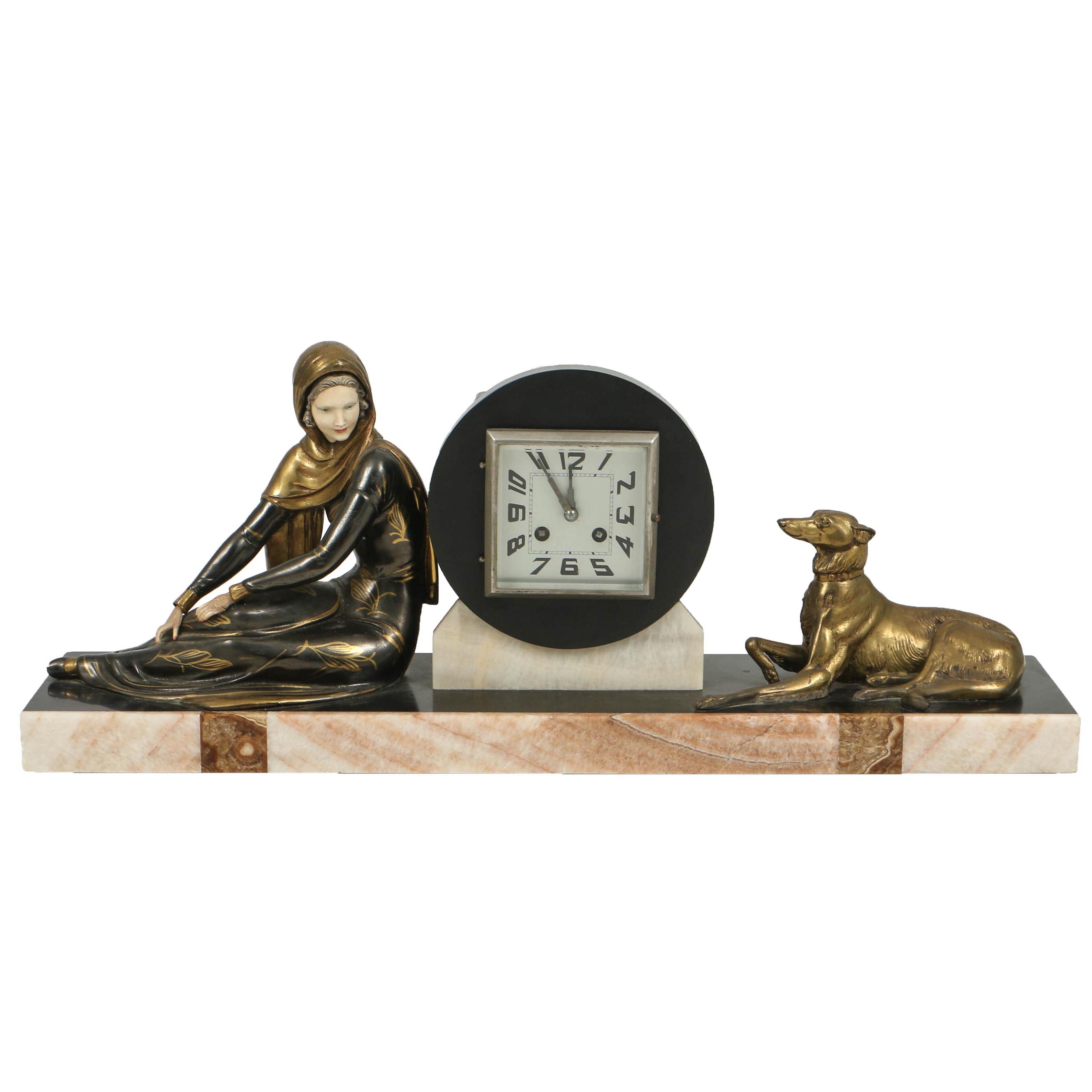 Art Deco Patinated Metal and Ivorine Figural Mantel Clock