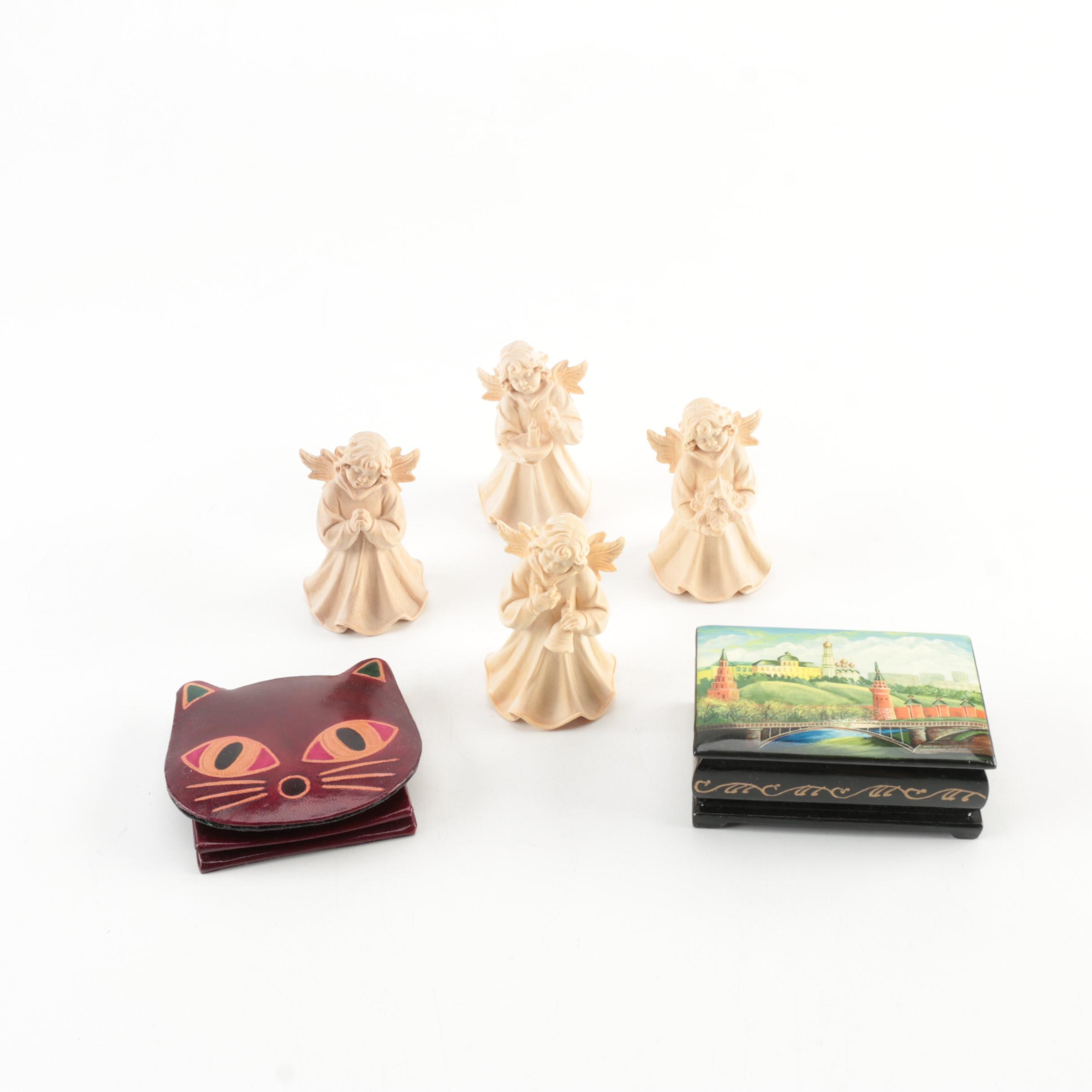 Selection of Decorative Pieces Featuring Holzschintzerei Carved Wooden Angels