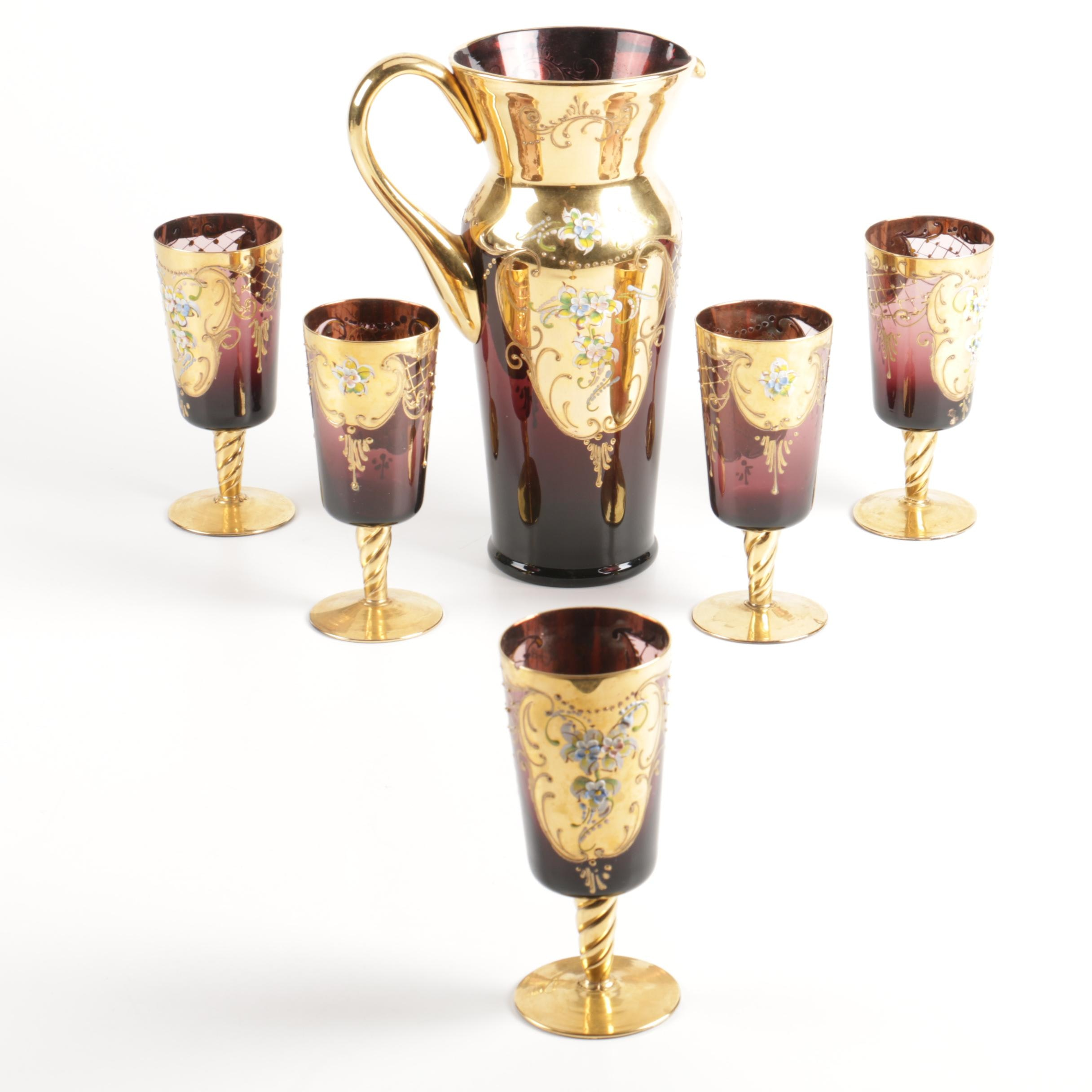 Gilded and Pomegranate Glass Pitcher and Footed Glasses