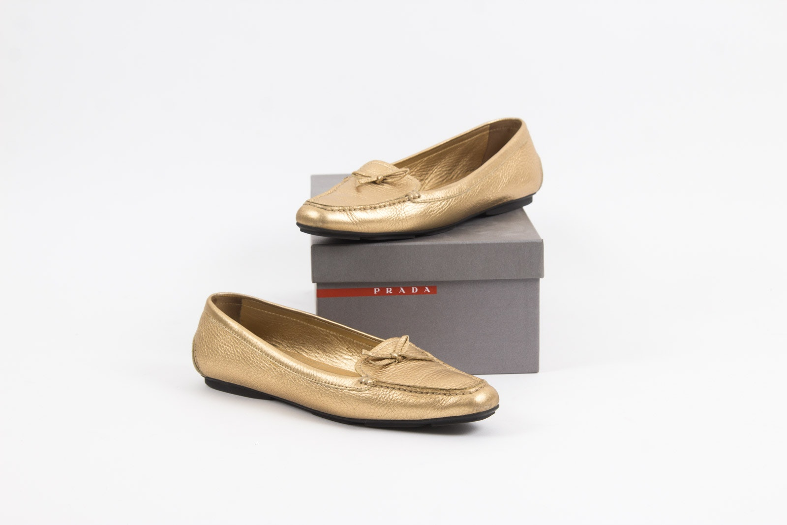 Prada Metallic Gold Tone Loafers