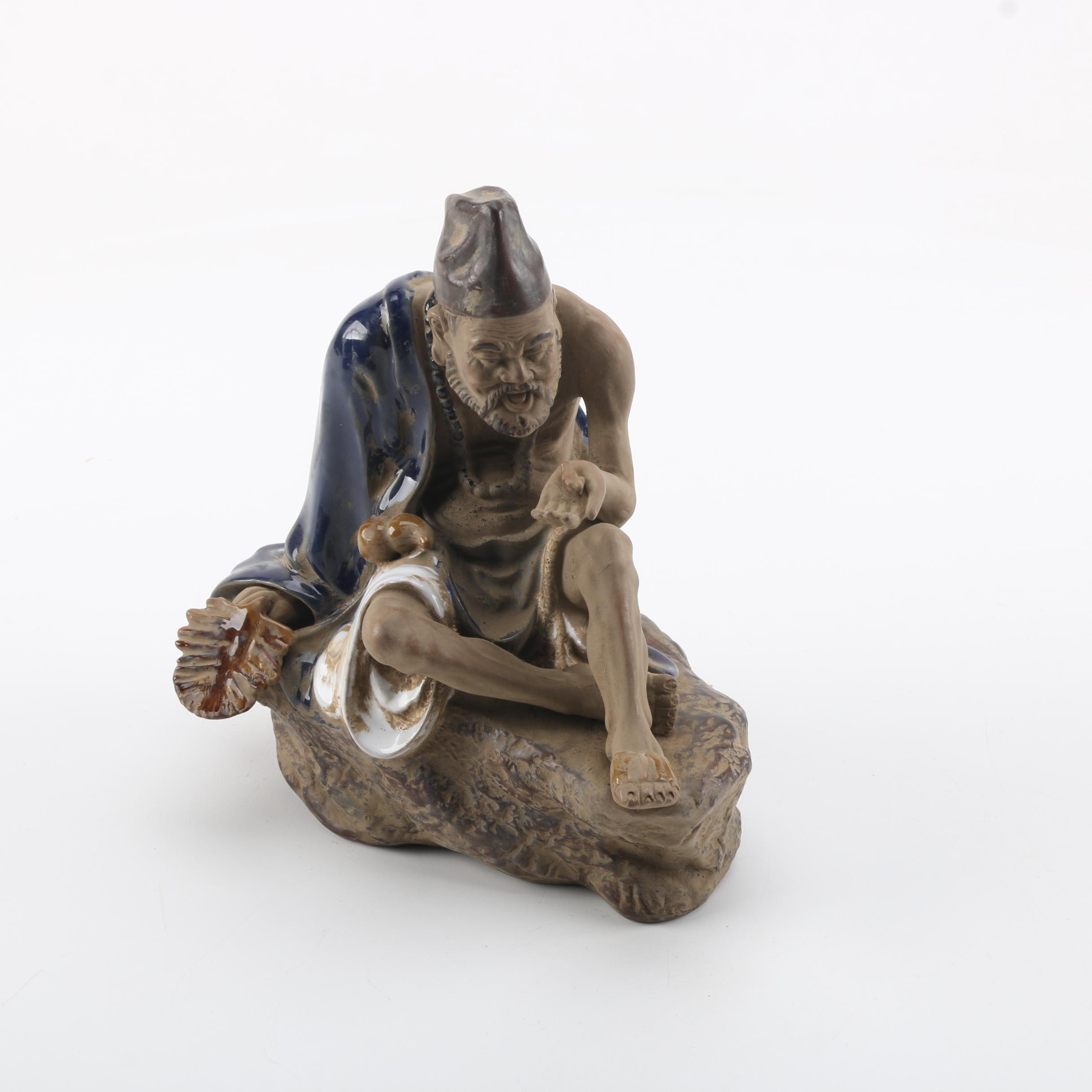 Chinese Figurine of a Sitting Man