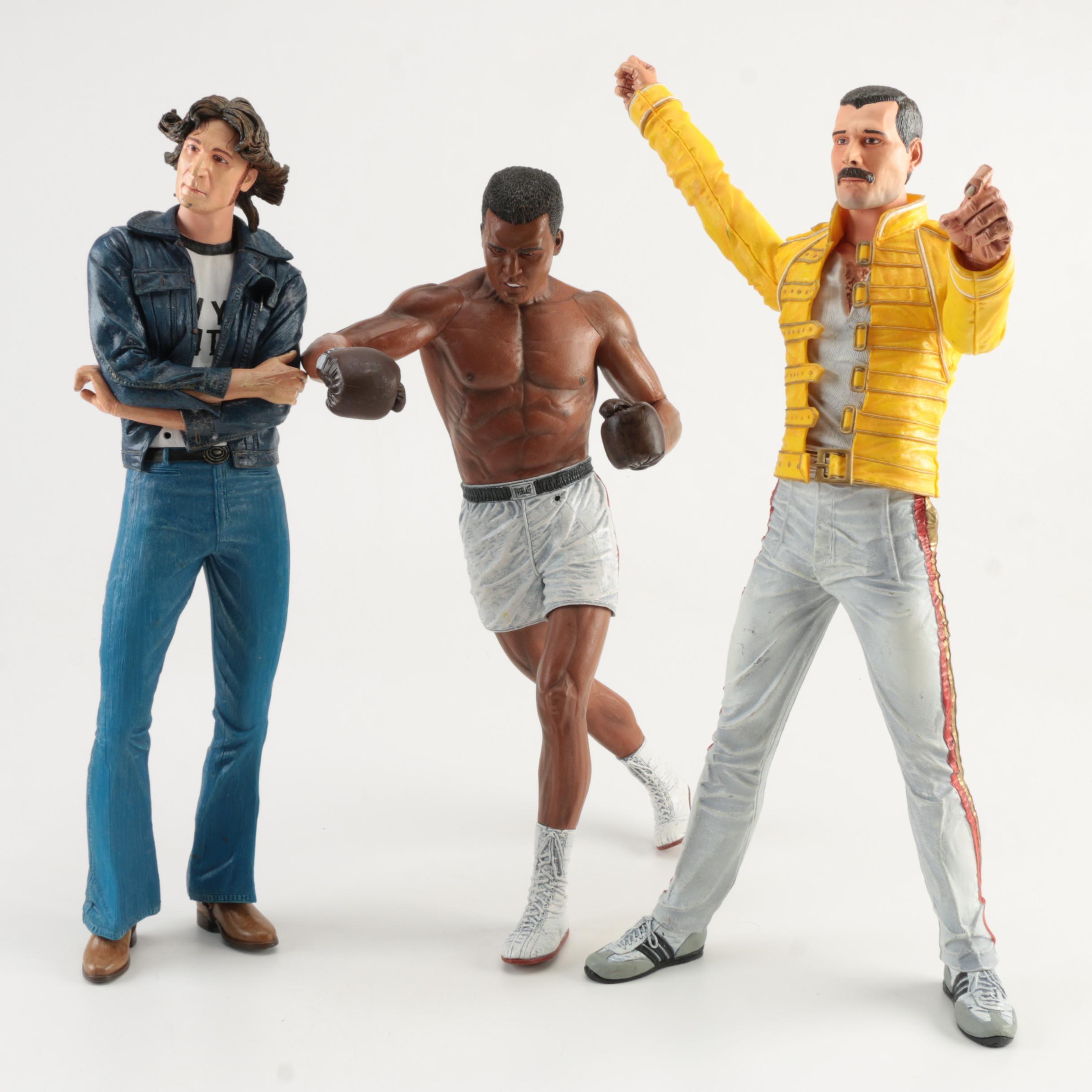 Plastic Dolls of Muhammad Ali, Freddie Mercury, and John Lennon