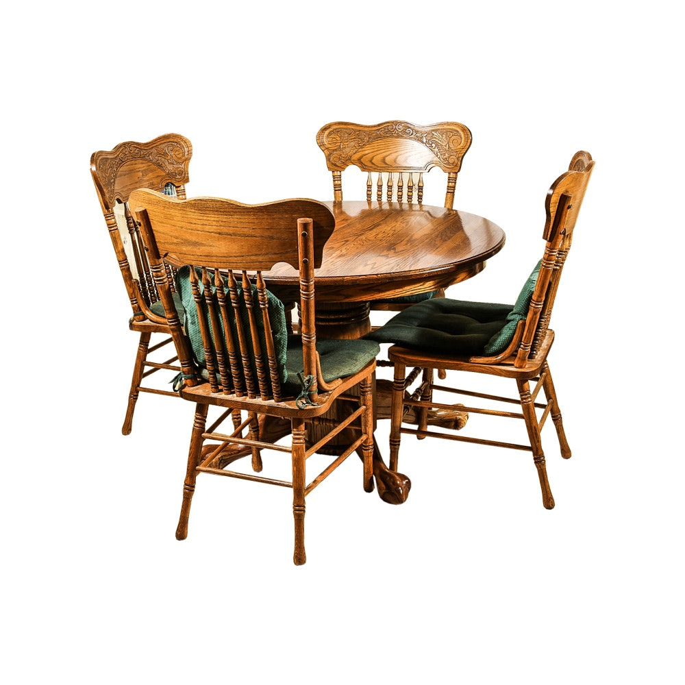 A Claw Foot Oak Dining Table and Chairs