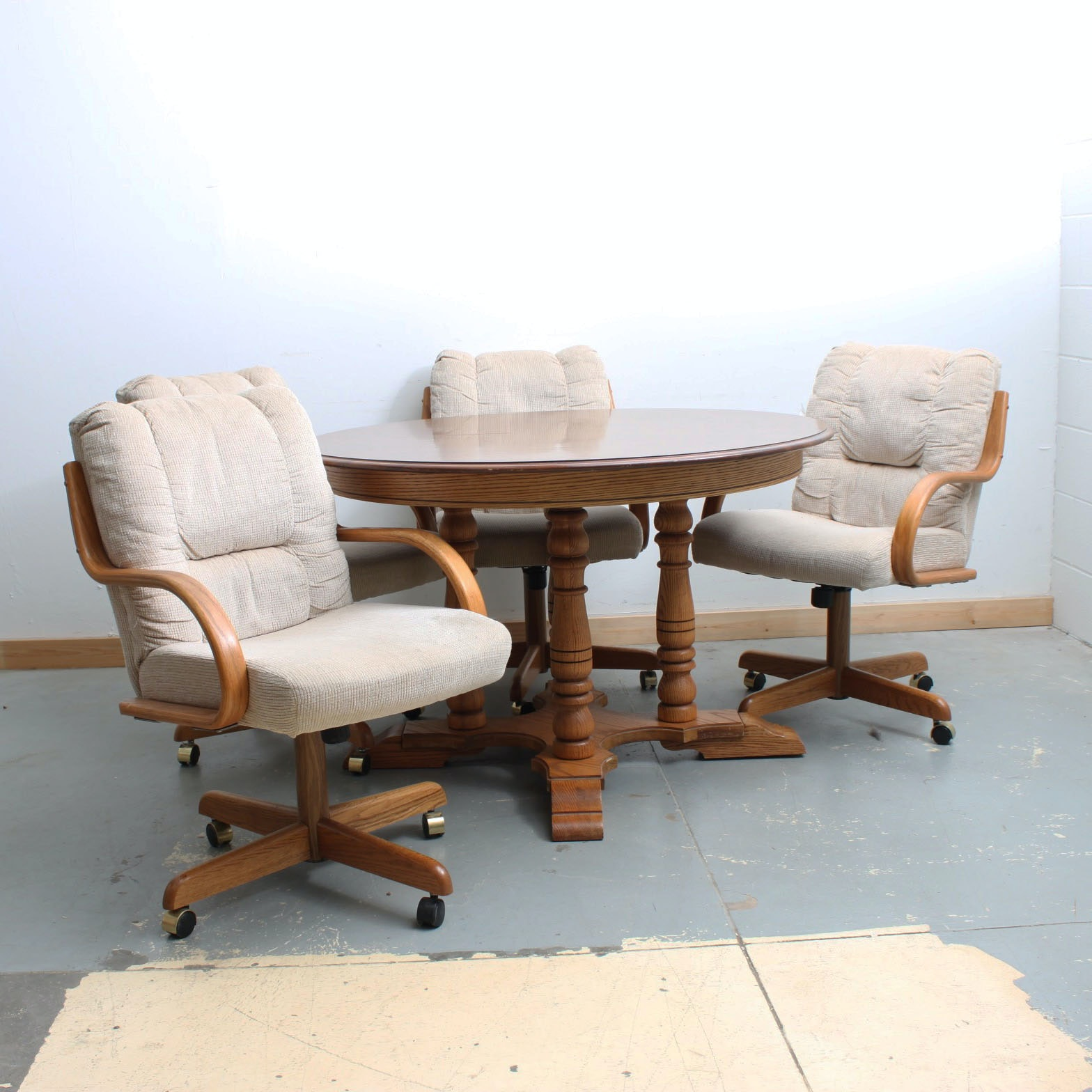 Pedestal Table and Four Rolling Armchairs