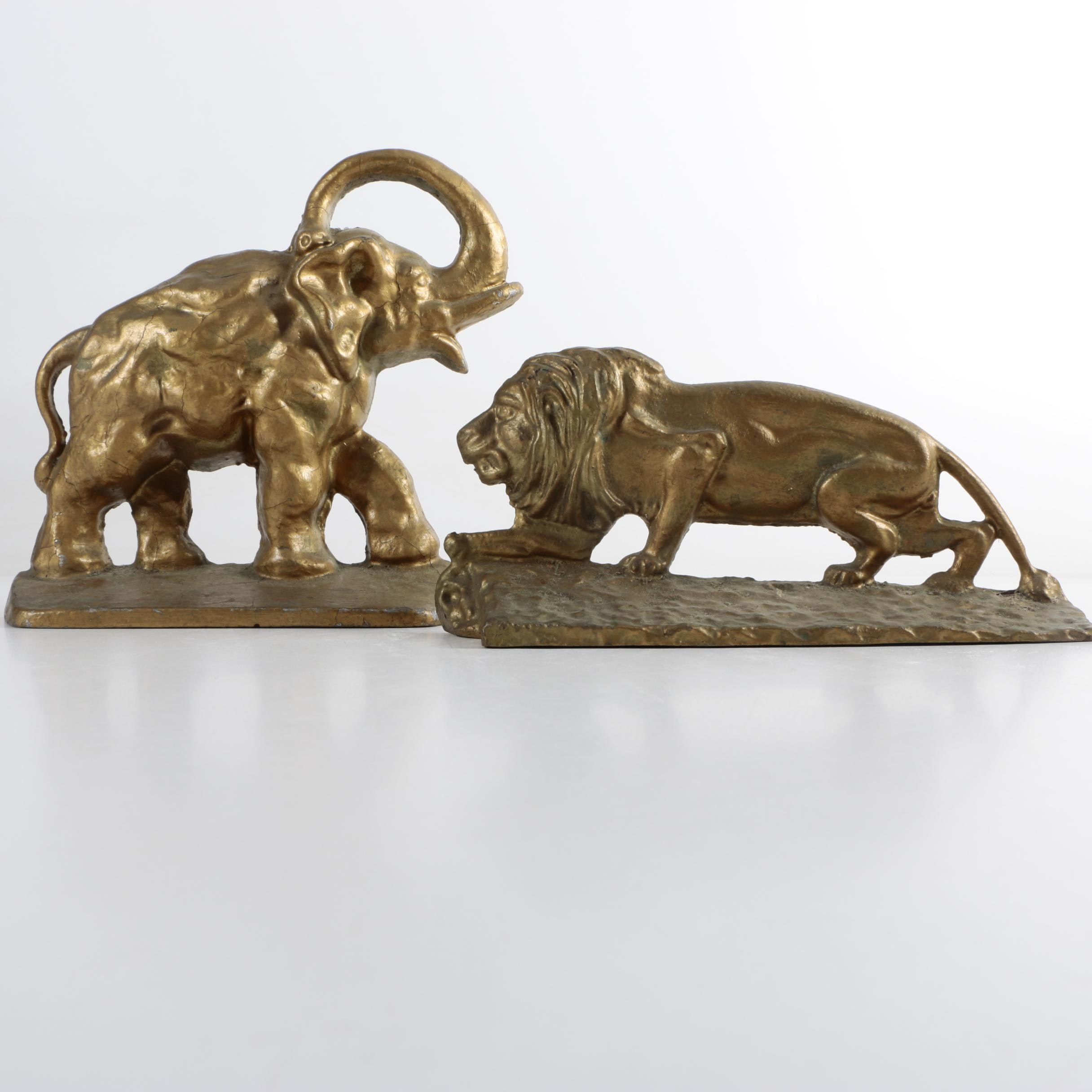 Vintage Cast Iron Lion and Elephant Doorstops