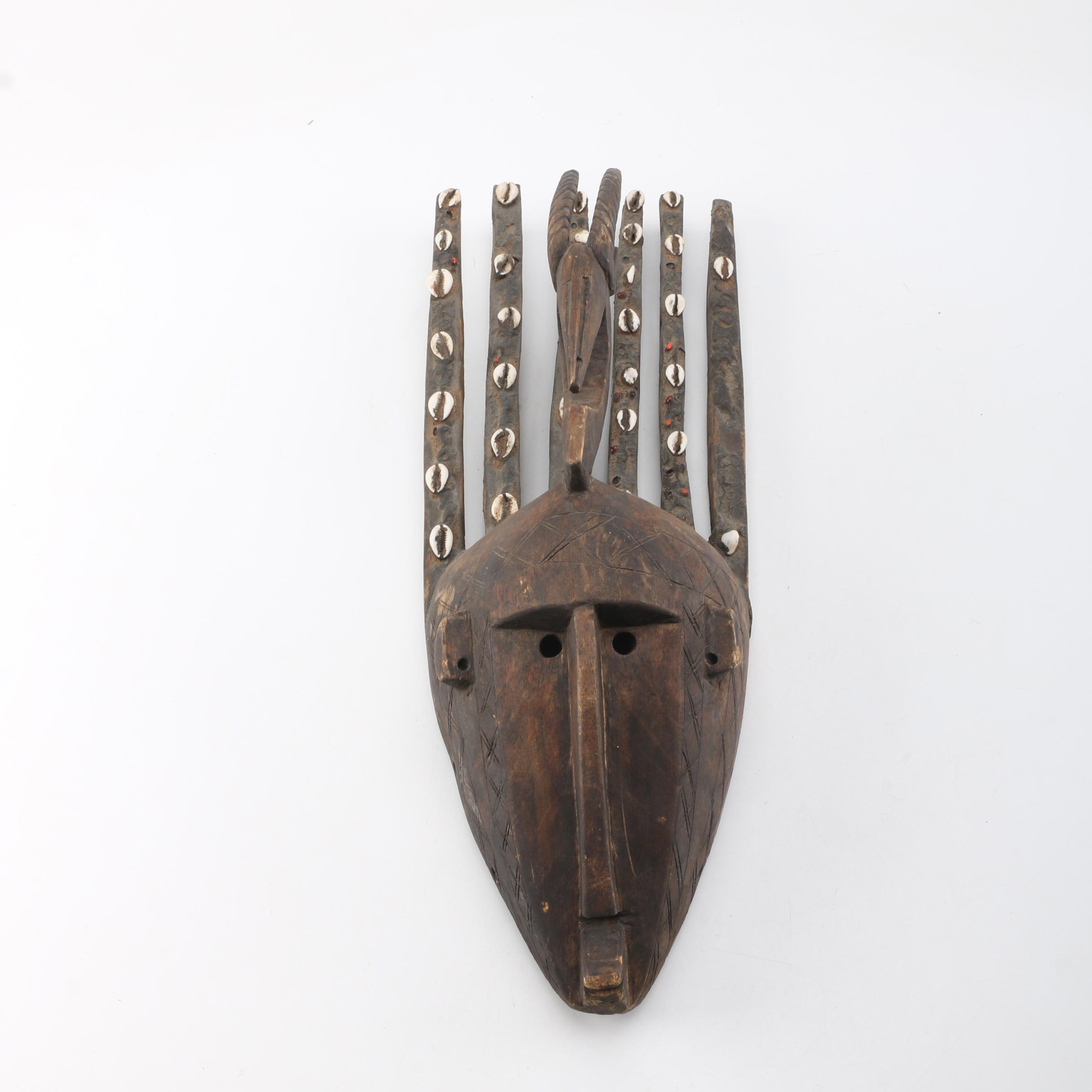 Bamana Carved Wood N'tomo Mask with Cowrie Shell and Bean Accents