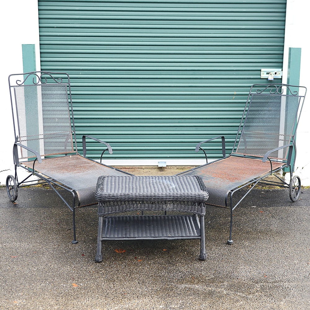 Metal Chaise Lounges and Wicker Table