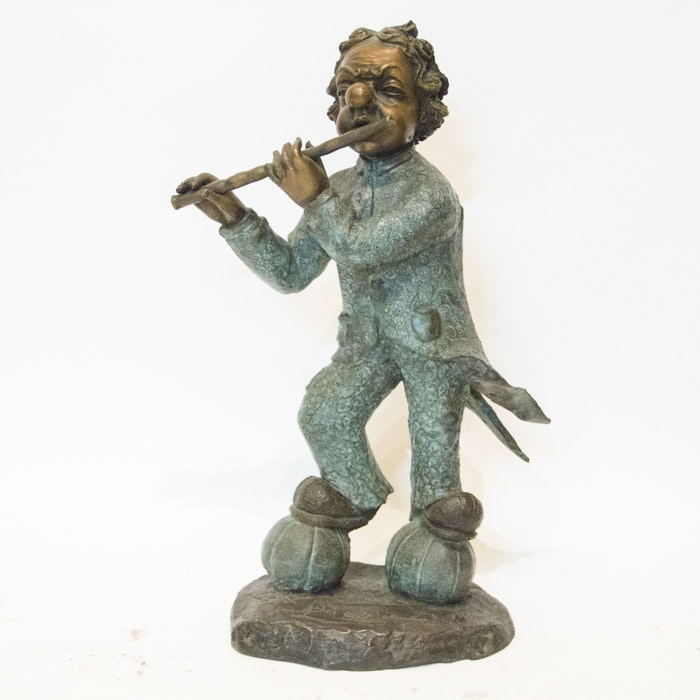 Bronze Tone Sculpture of a Clown with Flute