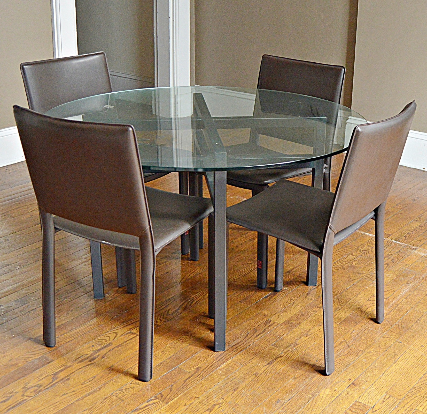 Contemporary Round Glass and Metal Dining Table with Four Faux Leather Chairs