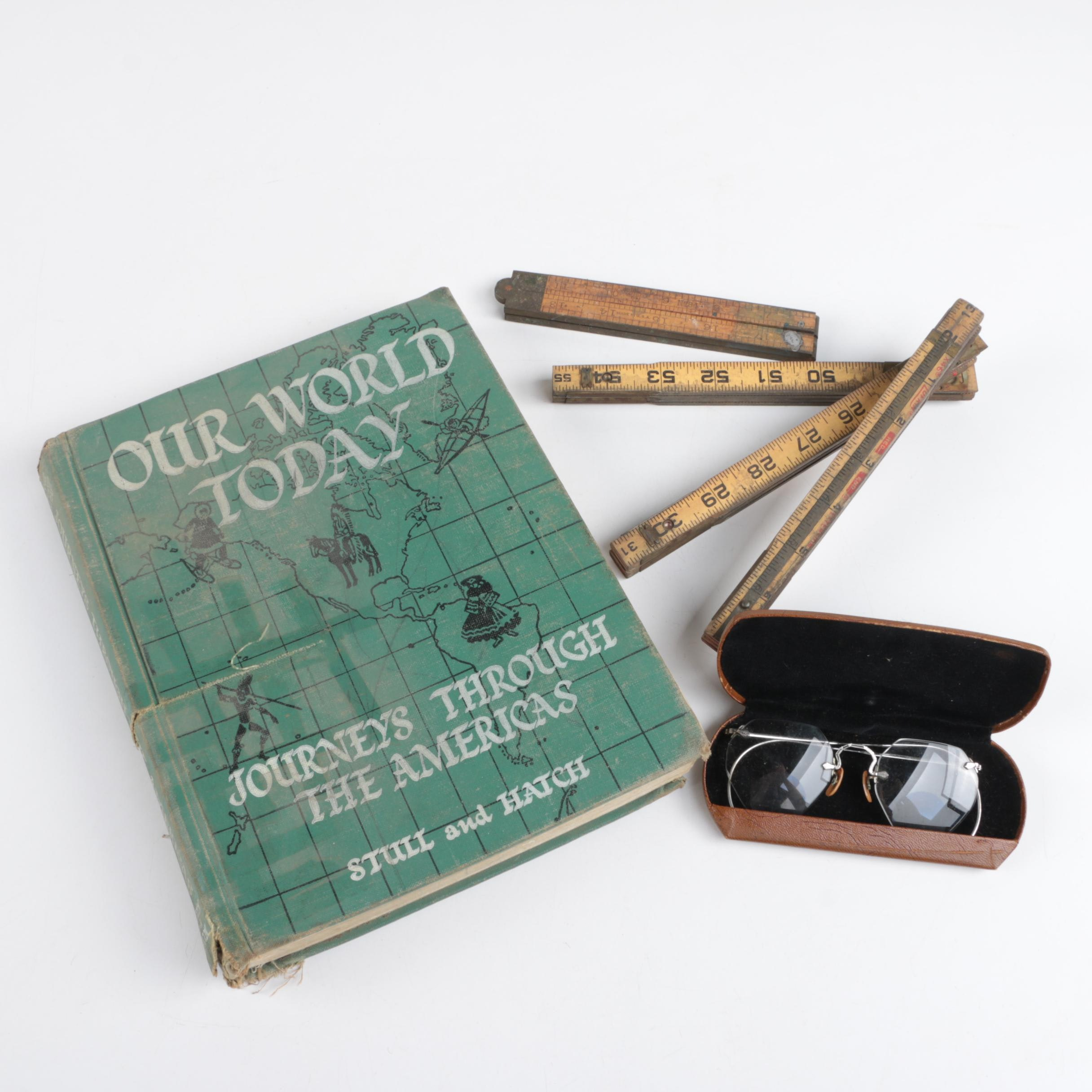 """Our World Today"" History Book with Rulers and Spectacles"