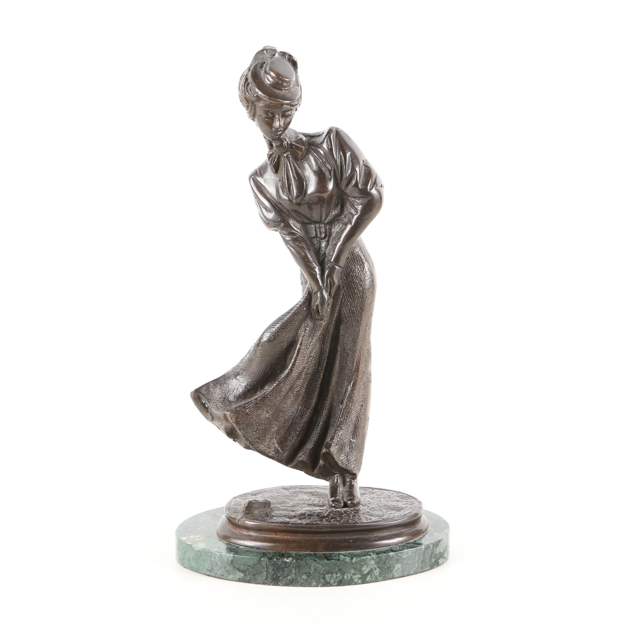 Cast Metal Sculpture of Woman Playing Golf