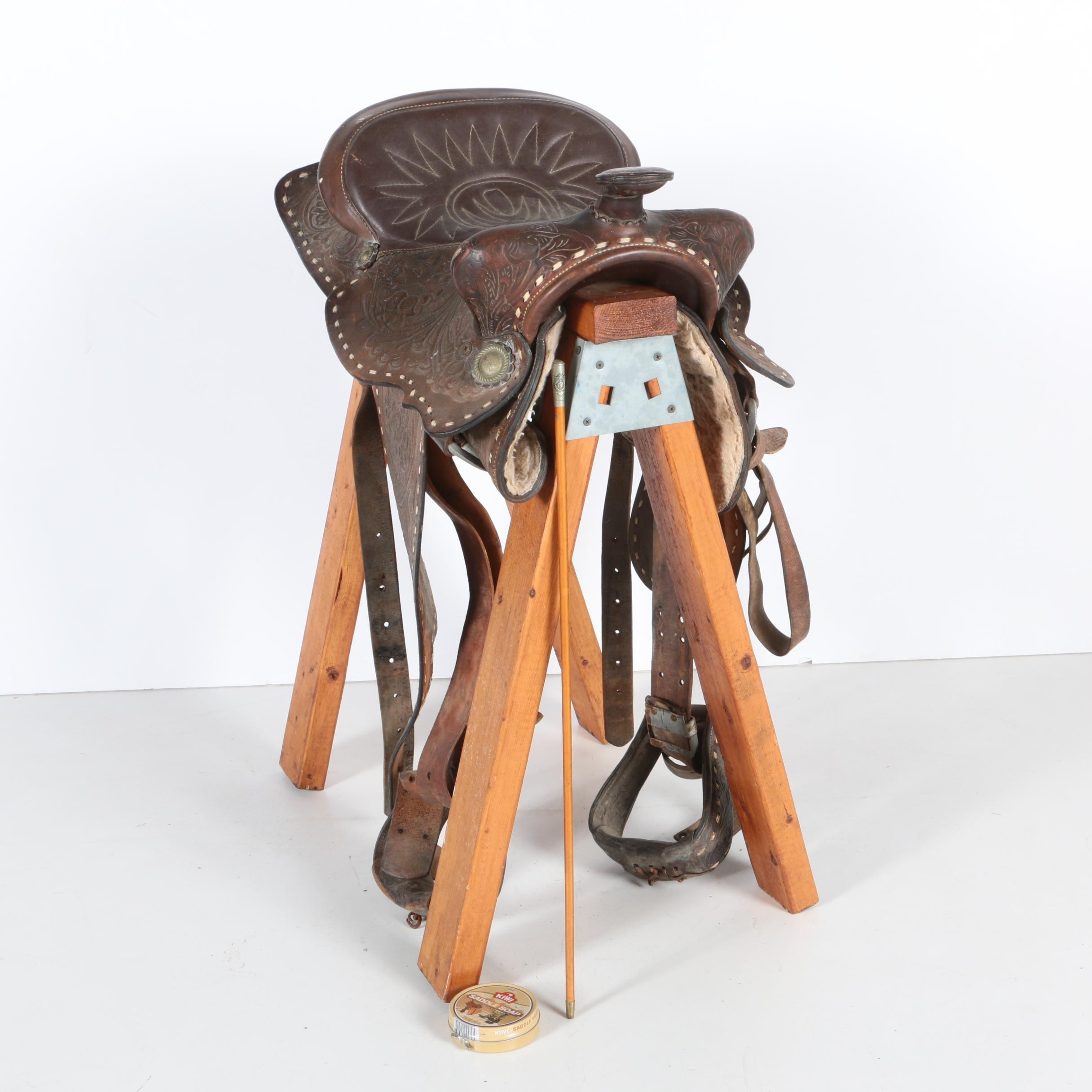 Vintage Brown Leather Saddle with Stand and English Riding Crop
