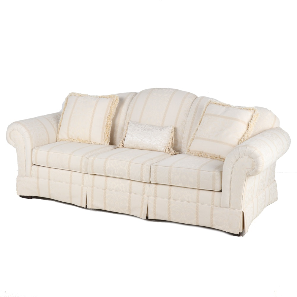 Cream and Tan Upholstered Sofa