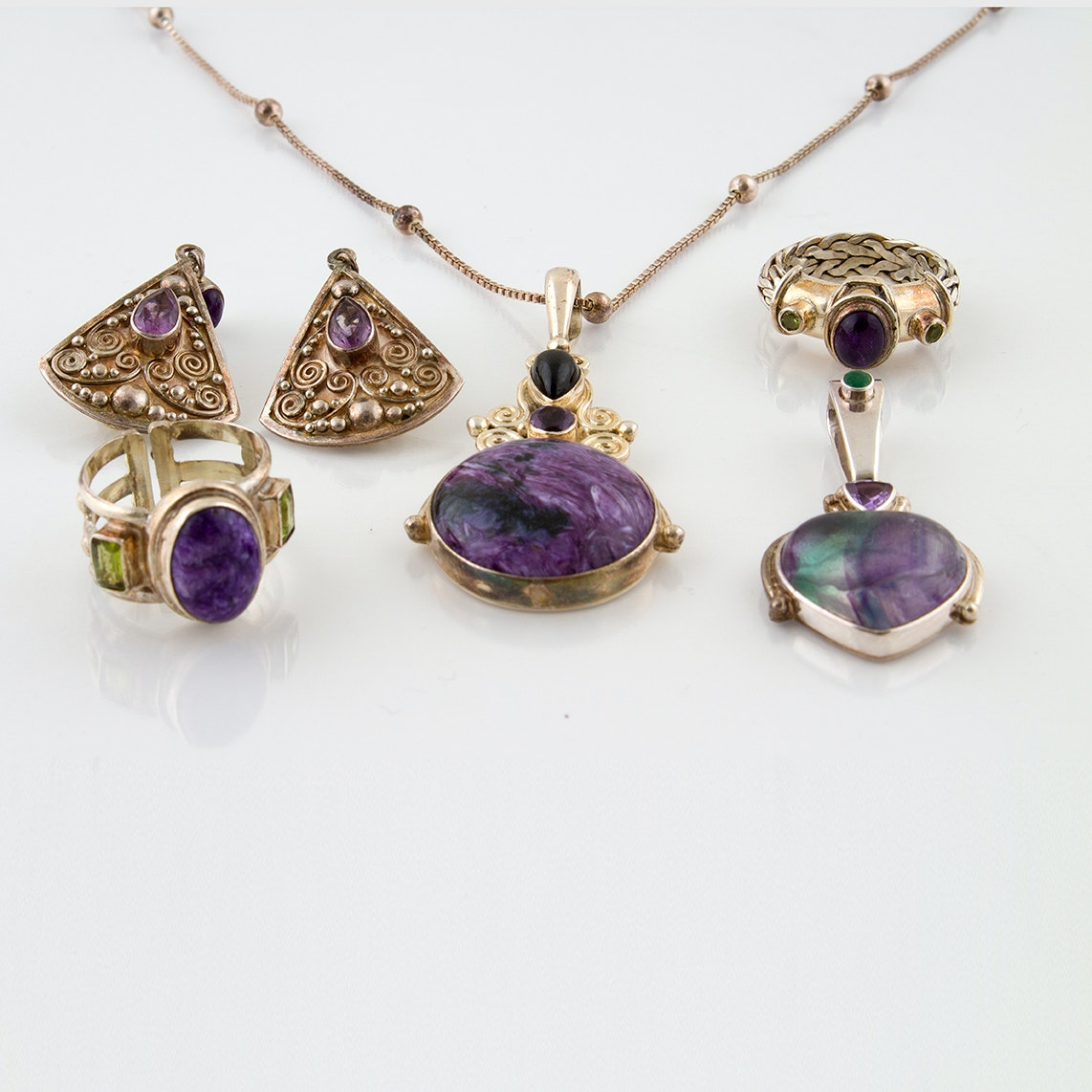 Sajen Sterling Silver Jewelry Featuring Peridot, Amethyst, and Oiled Emeralds