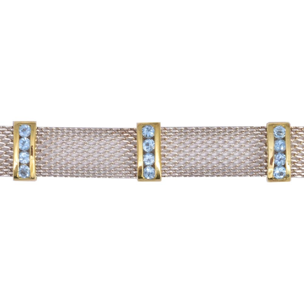 Sterling Bracelet With 2.60 CTW Blue Topaz Stones in Gold Washed Frames