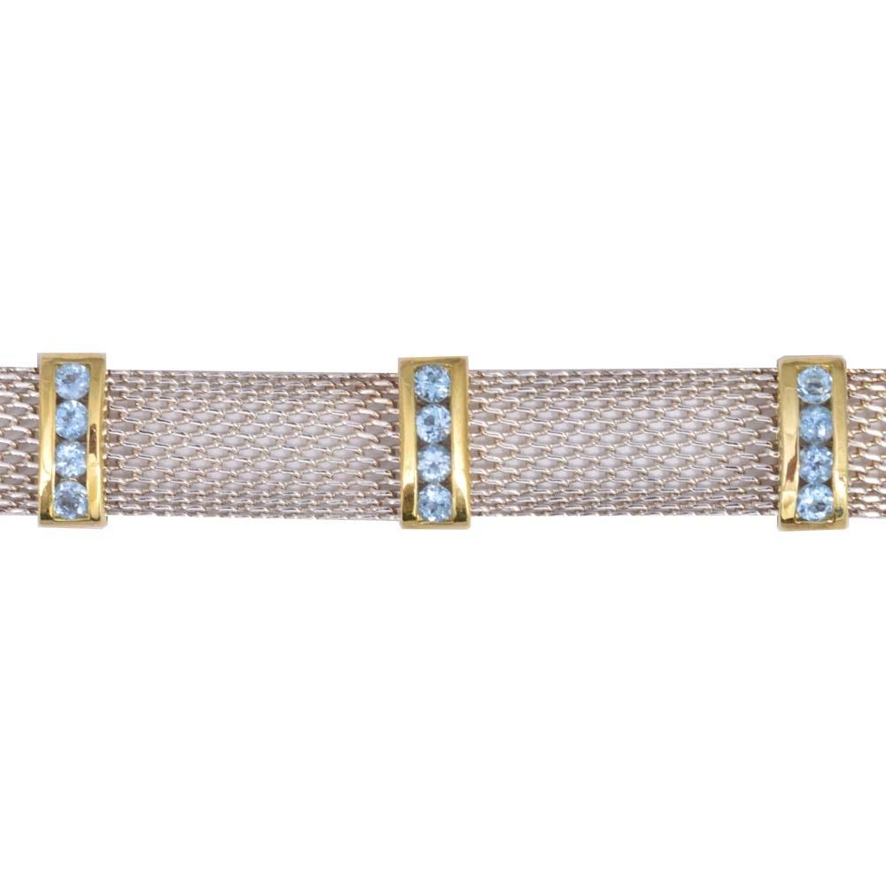 Sterling Bracelet With 2.60 CTW Blue Topaz Stones in Gold Washed Frames