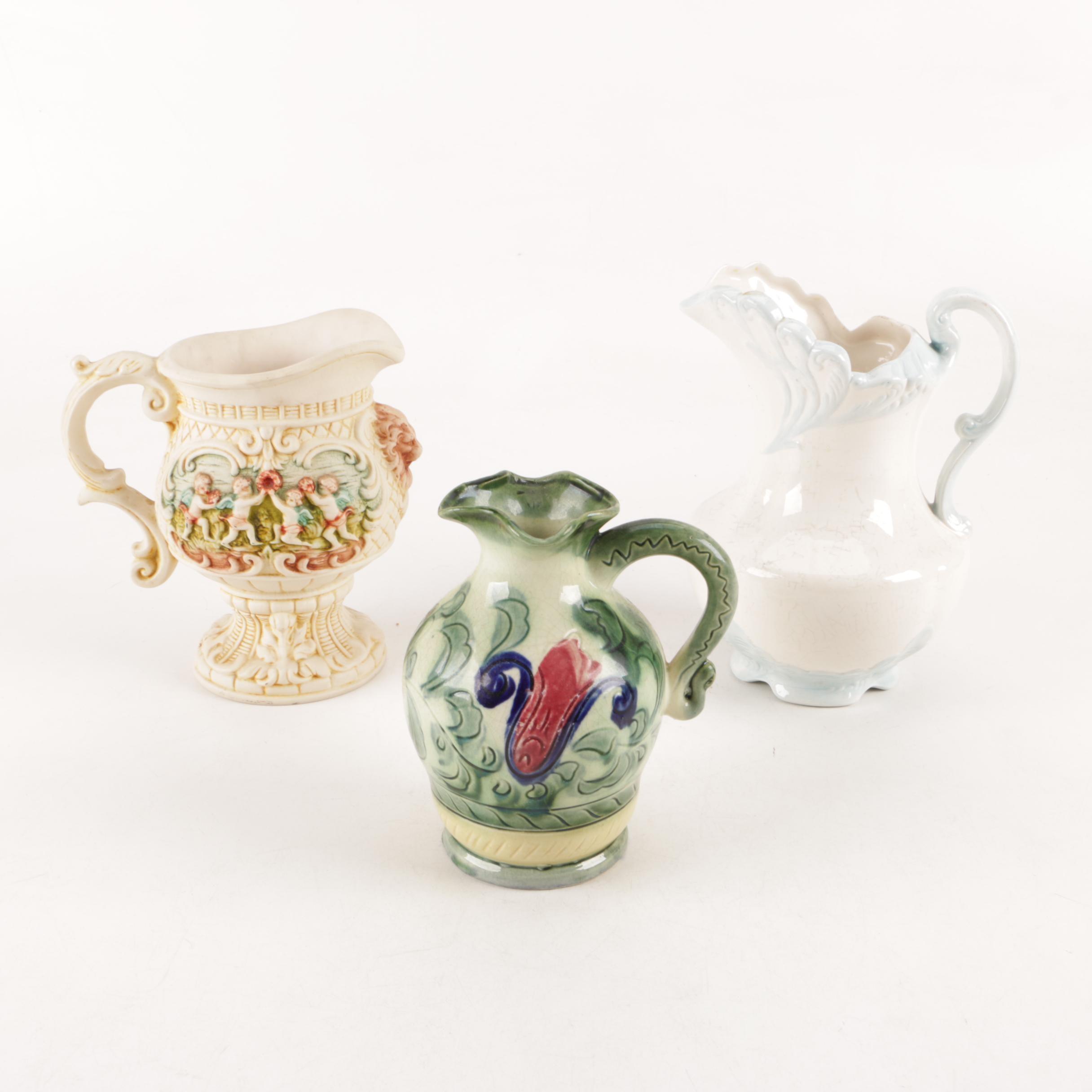 Capodimonte Style Cherub Pitcher and Ceramic Pitchers